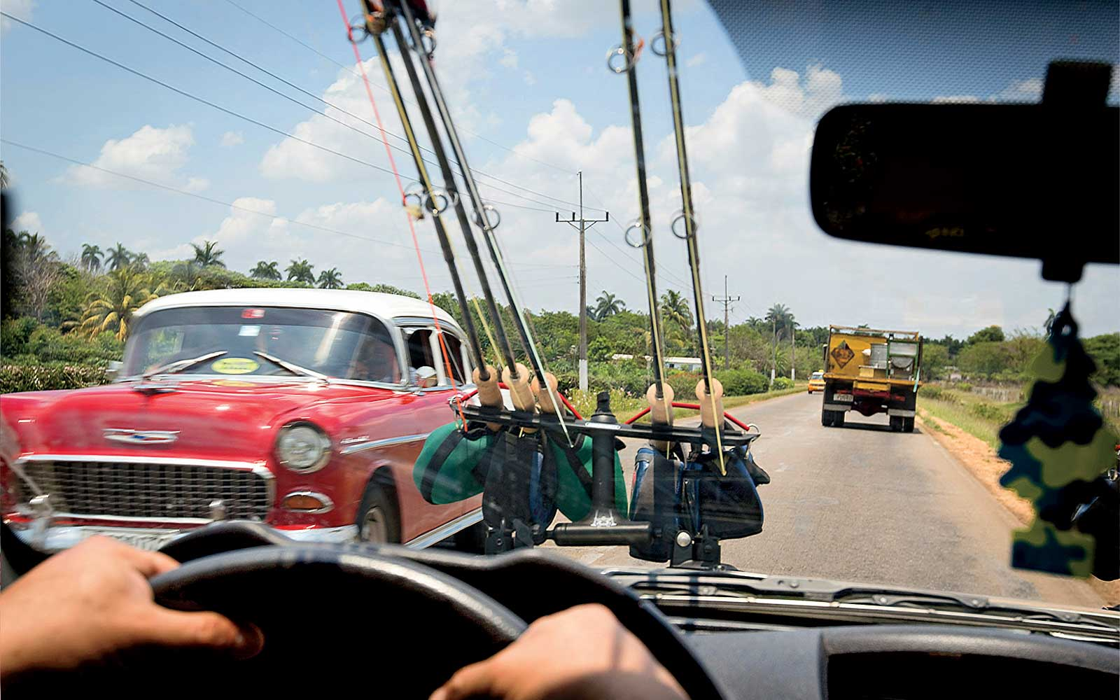 Fly fishing gear strapped to a car in Cuba