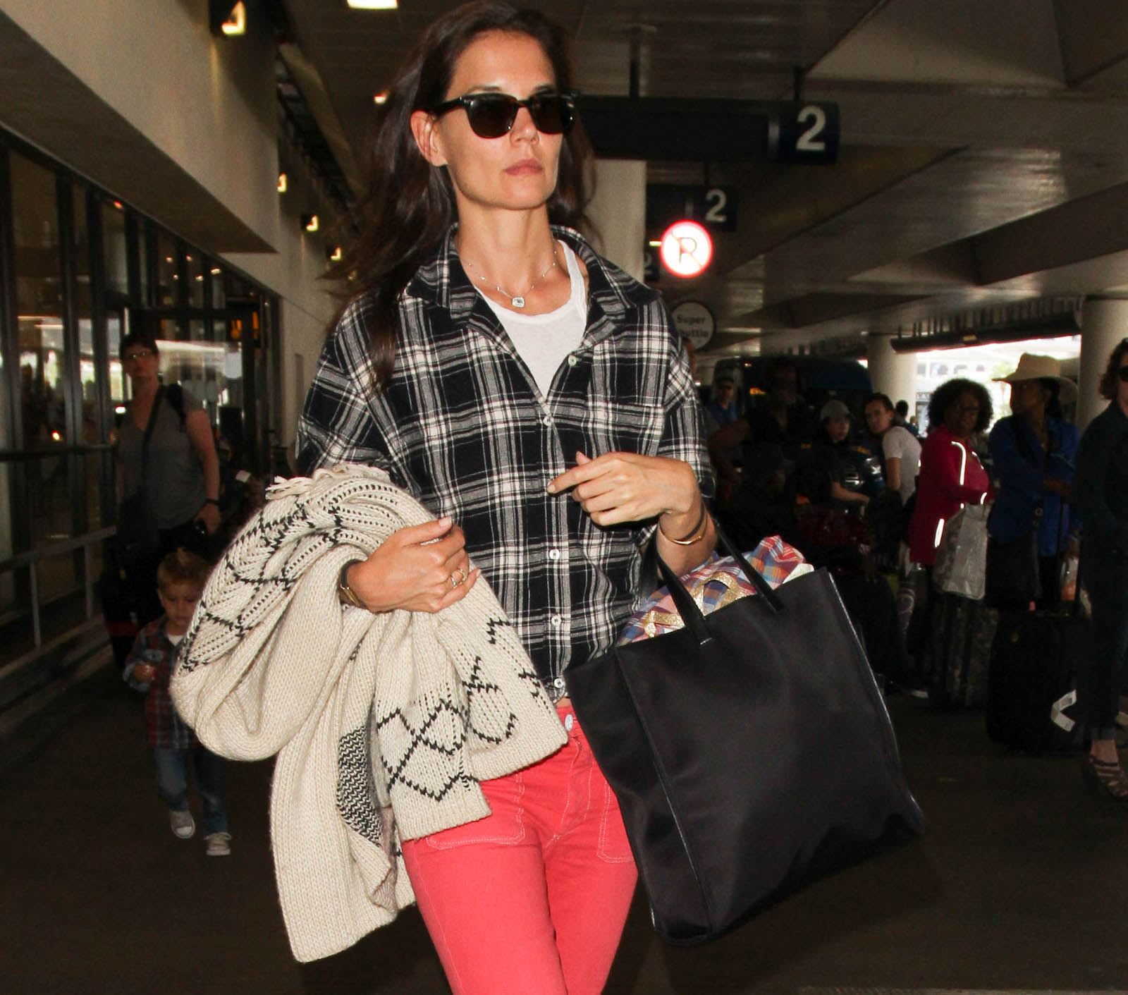 Katie Holmes carries a large scarf at LAX