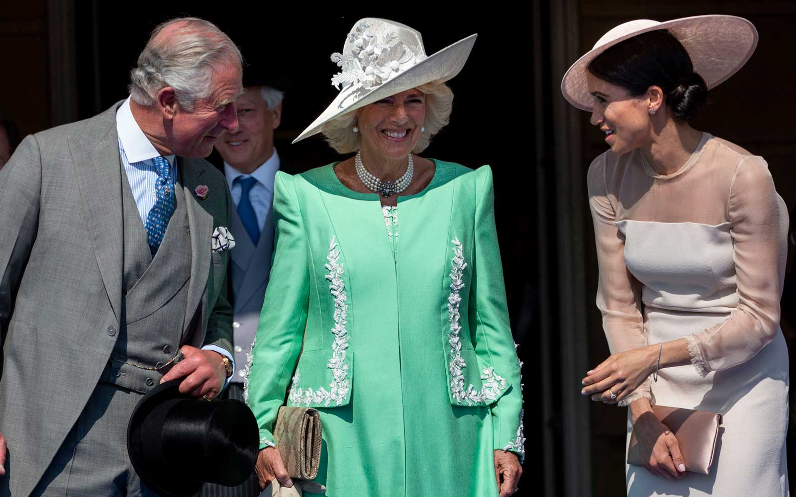 Prince Charles, Prince of Wales and Camilla, Duchess of Cornwall with Meghan, Duchess of Sussex