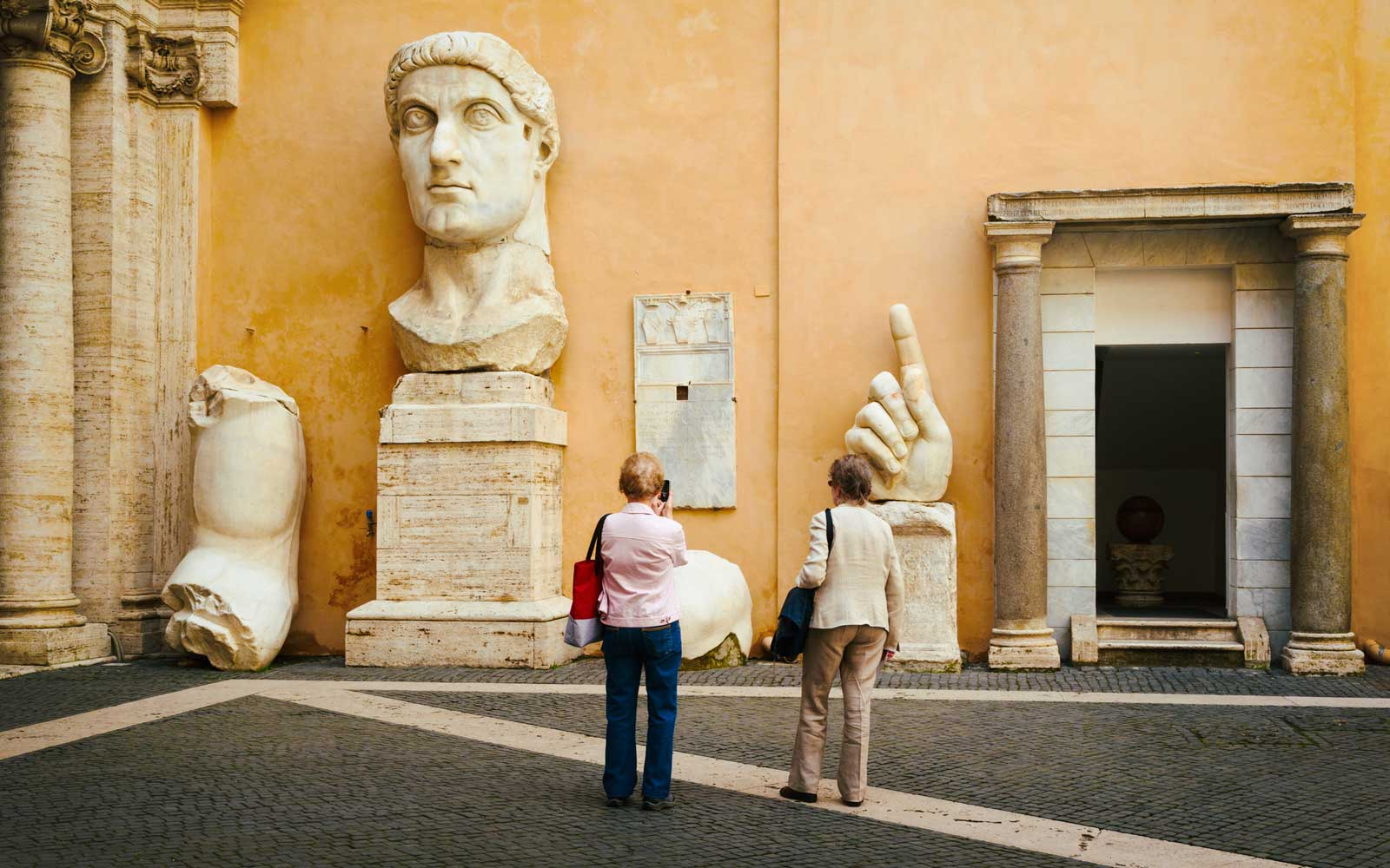 The Capitoline Museum. Courtyard of the Palazzo dei Conservatori.  Pieces of the colossal statue of the Emperor Constantine.   The Historic Centre of Rome is a UNESCO World Heritage Site.