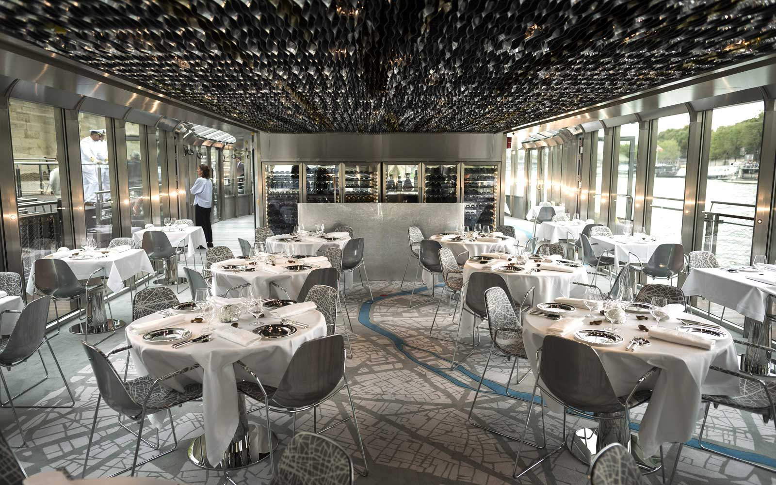 "Dressed tables are seen at Alain Ducasse's new boat restaurant, the ""Ducasse sur Seine"", on August 30, 2018 in Paris."