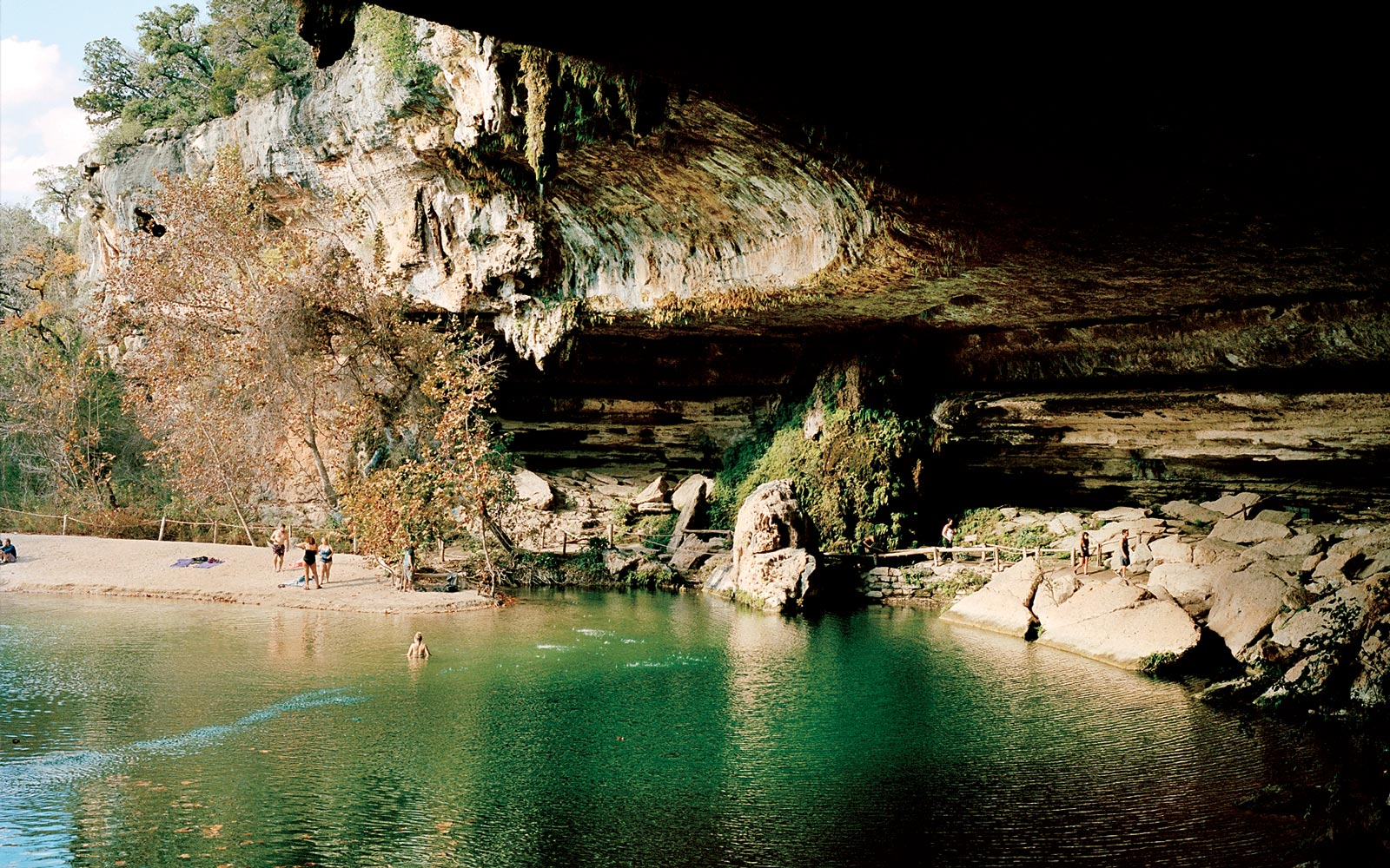 Swimmers at Hamilton Pool, near Austin, Texas