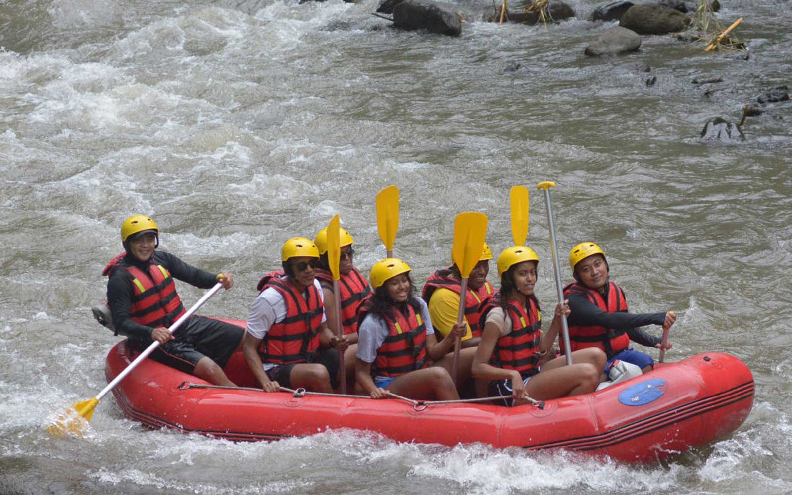 Former US president Barack Obama, his wife Michelle and his daughters Sasha and Malia go rafting at Bongkasa Village in Badung on Bali island