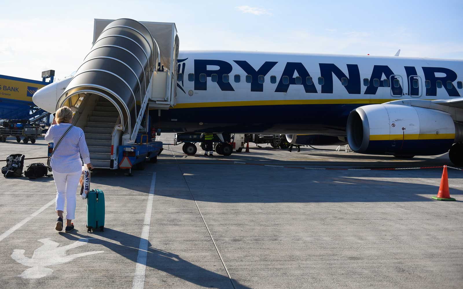 Passengers seen boarding Ryanair aircraft Boeing 737-800 at Krakow John Paul II International Airport.