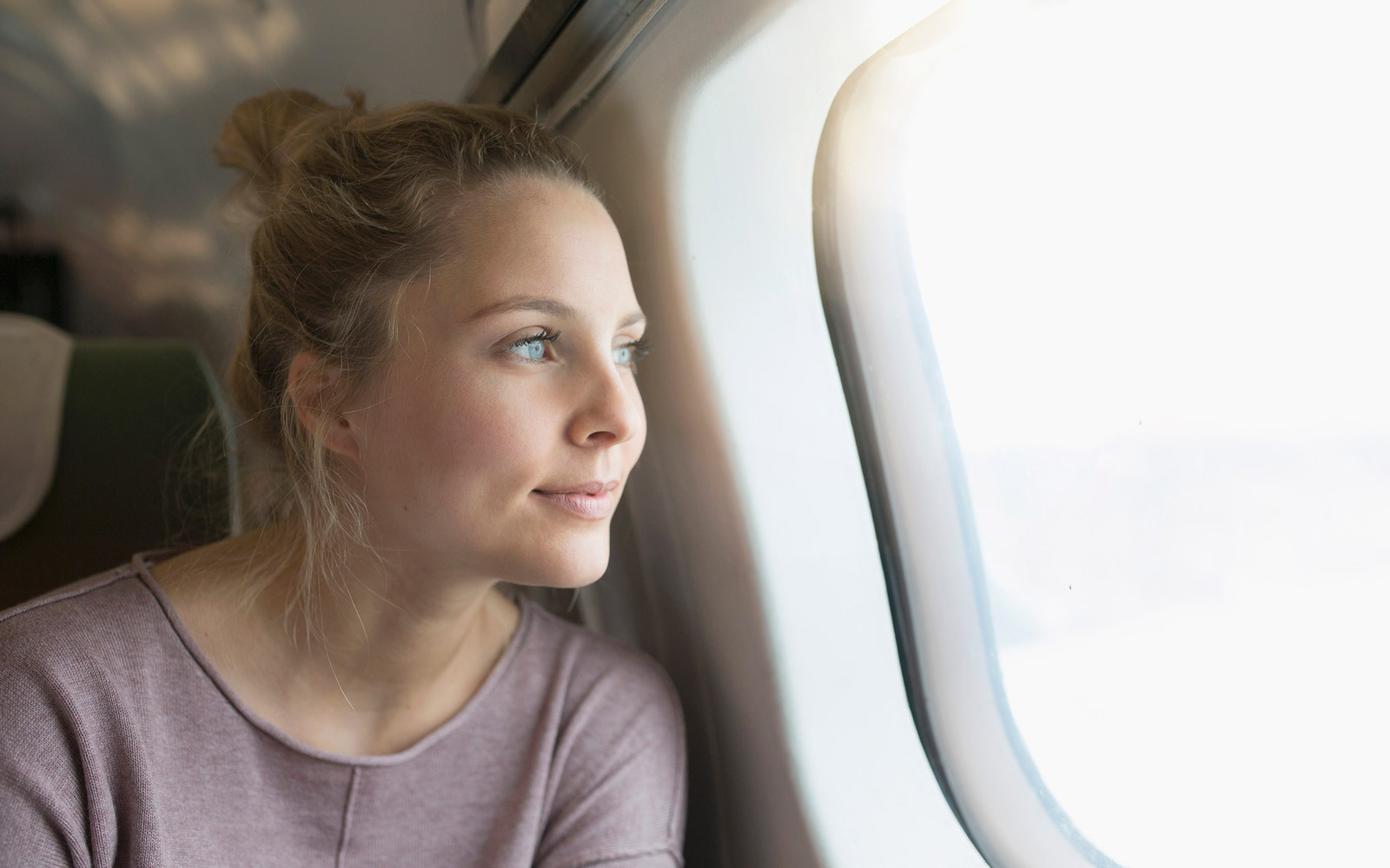 woman on plane with great skin