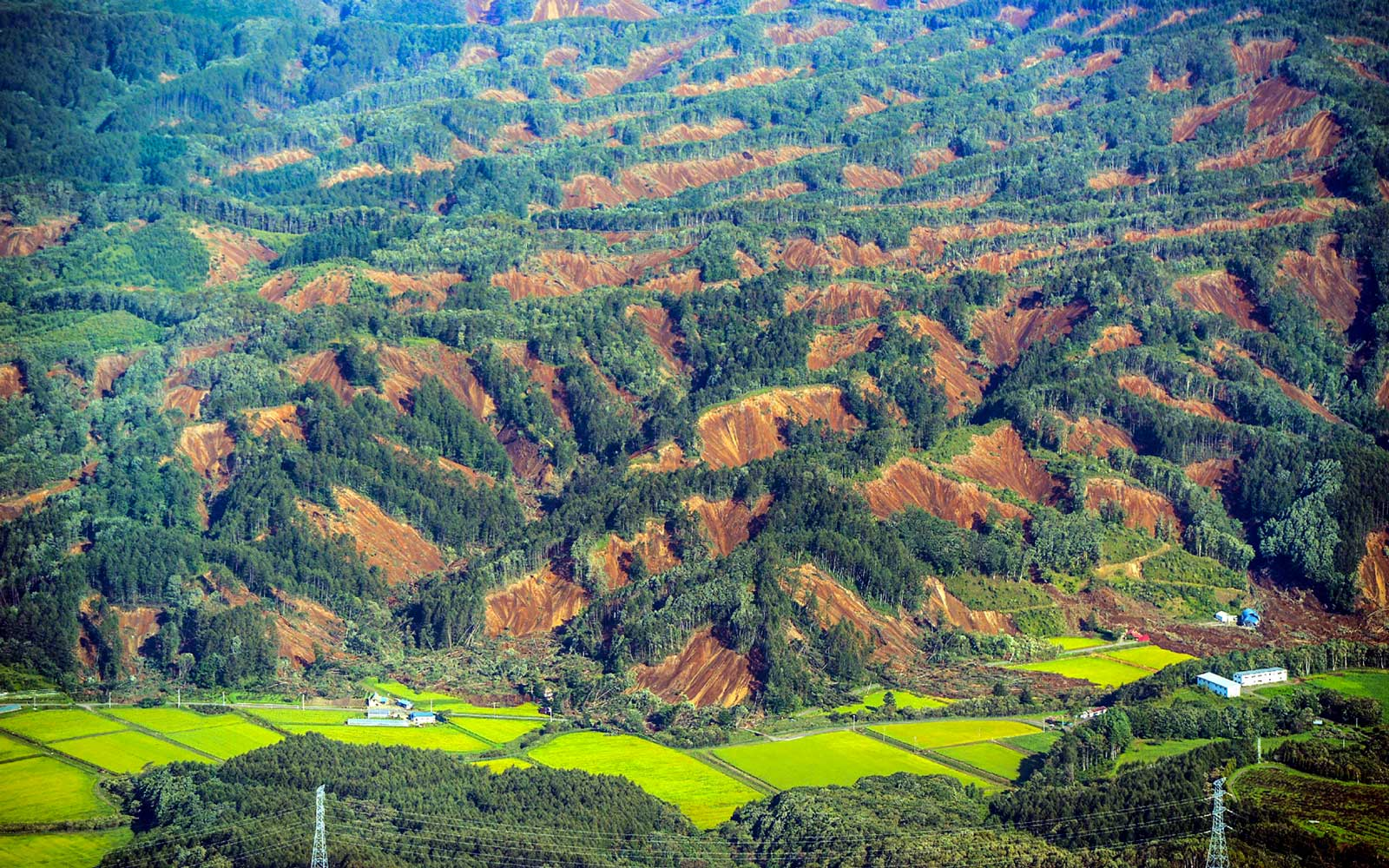 This picture shows an aerial view of landslides in Atsuma town, Hokkaido prefecture on September 6, 2018, after an earthquake hit the northern Japanese island of Hokkaido.