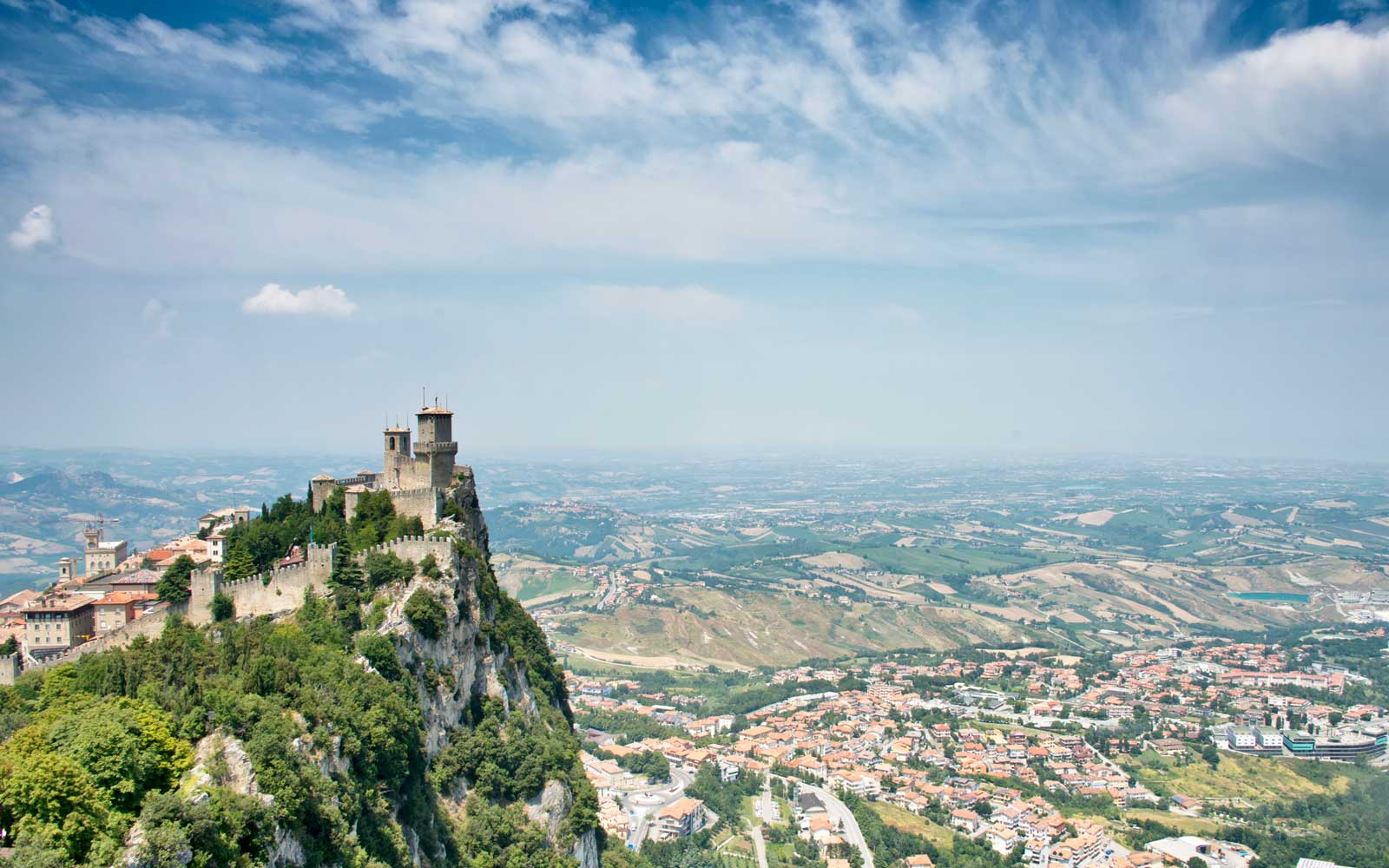 Guaita fortress in San Marino with valley in background.