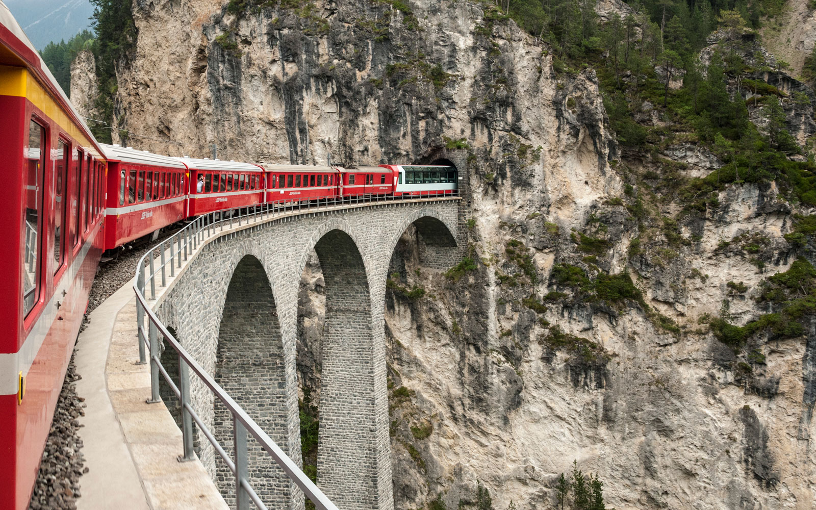 The Glacier Express train winds through narrow valleys and 92 tunnels.