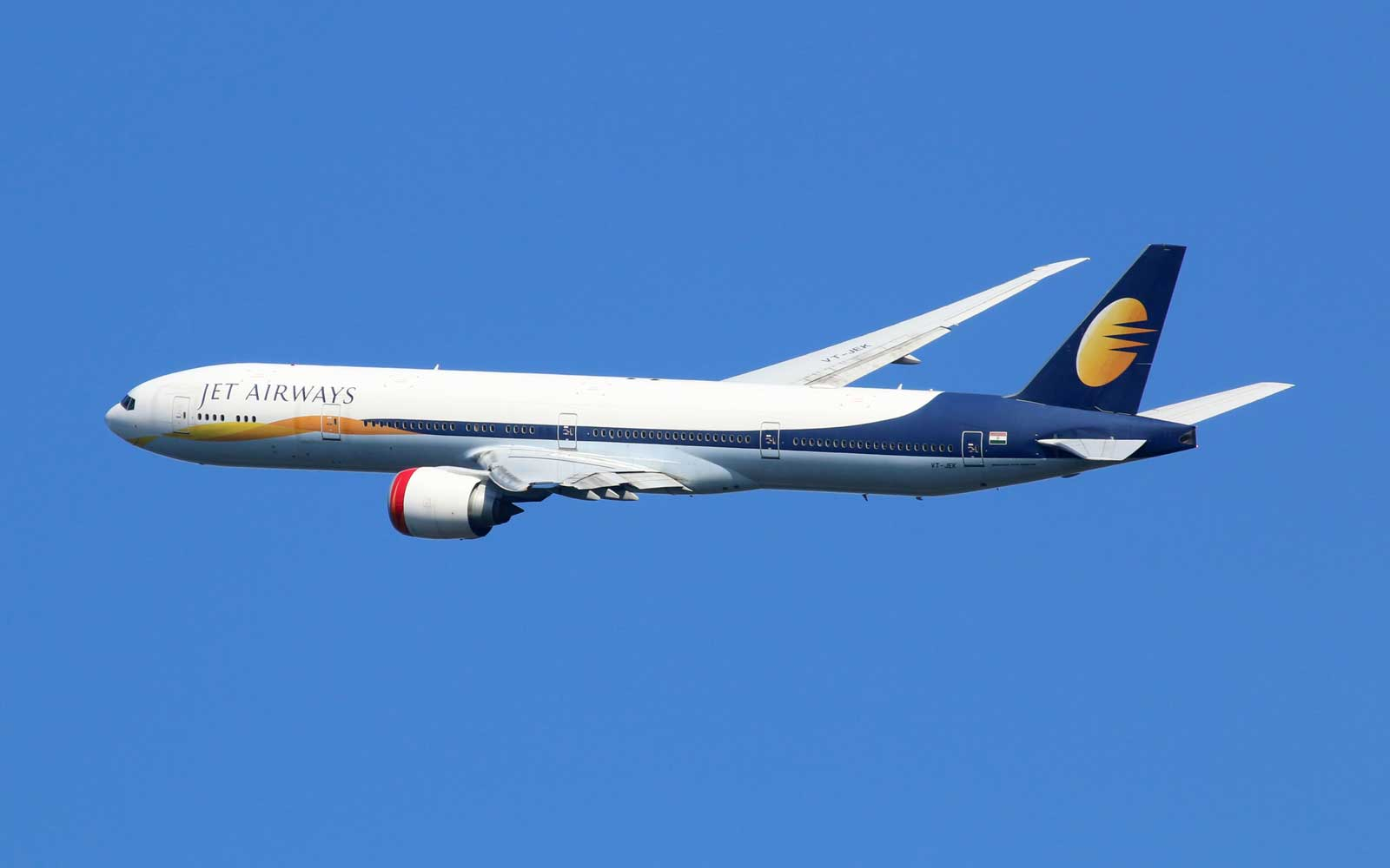 A Jet Airways Boeing 777-300ER with the registration VT-JEK taking off from London Heathrow Airport (LHR) in the United Kingdom. Jet Airways is the largest private carrier airline in India based in Mumbai.