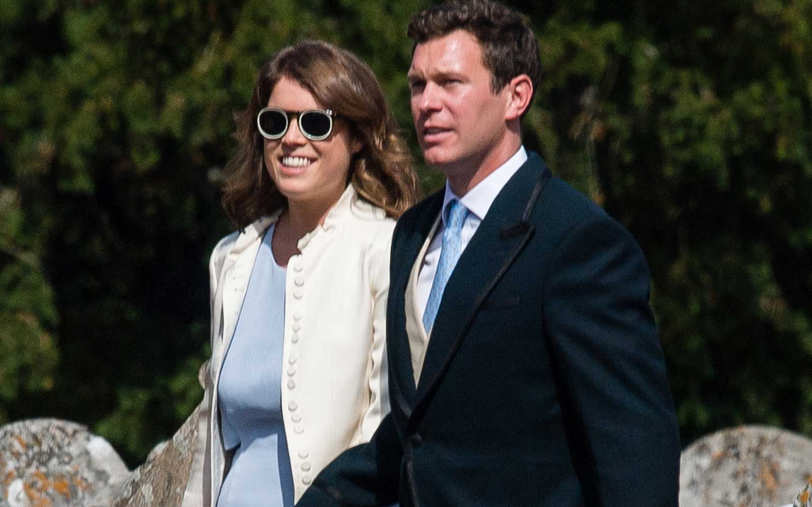 Princess Eugenie and fiance Jack Brooksbank attend the wedding of Charlie Van Straubenzee on August 4, 2018 in Frensham, United Kingdom.