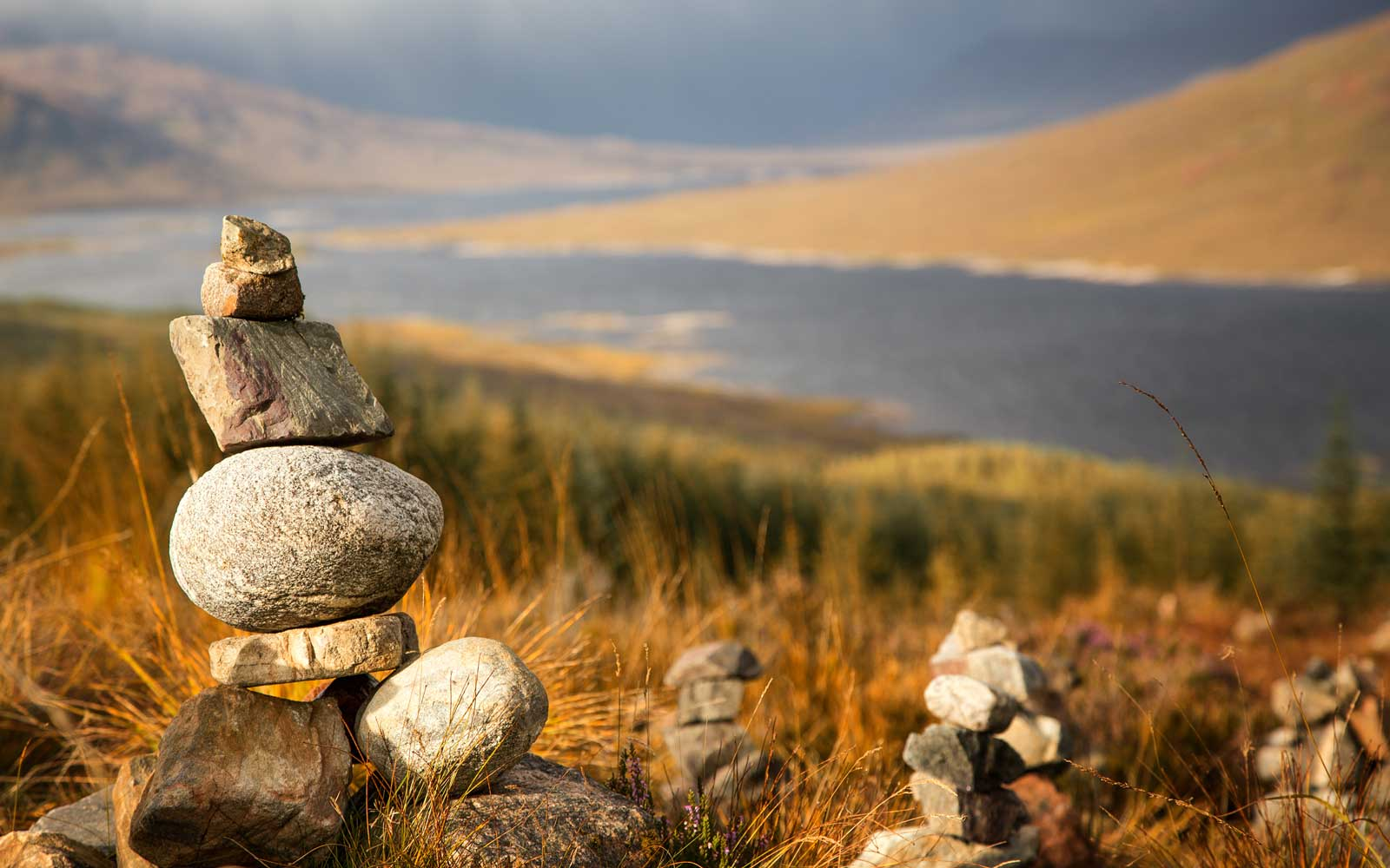 Stone stacks in the Scottish Highlands, overlooking the Ardochy Forest towards Loch Garry, Scotland, UK