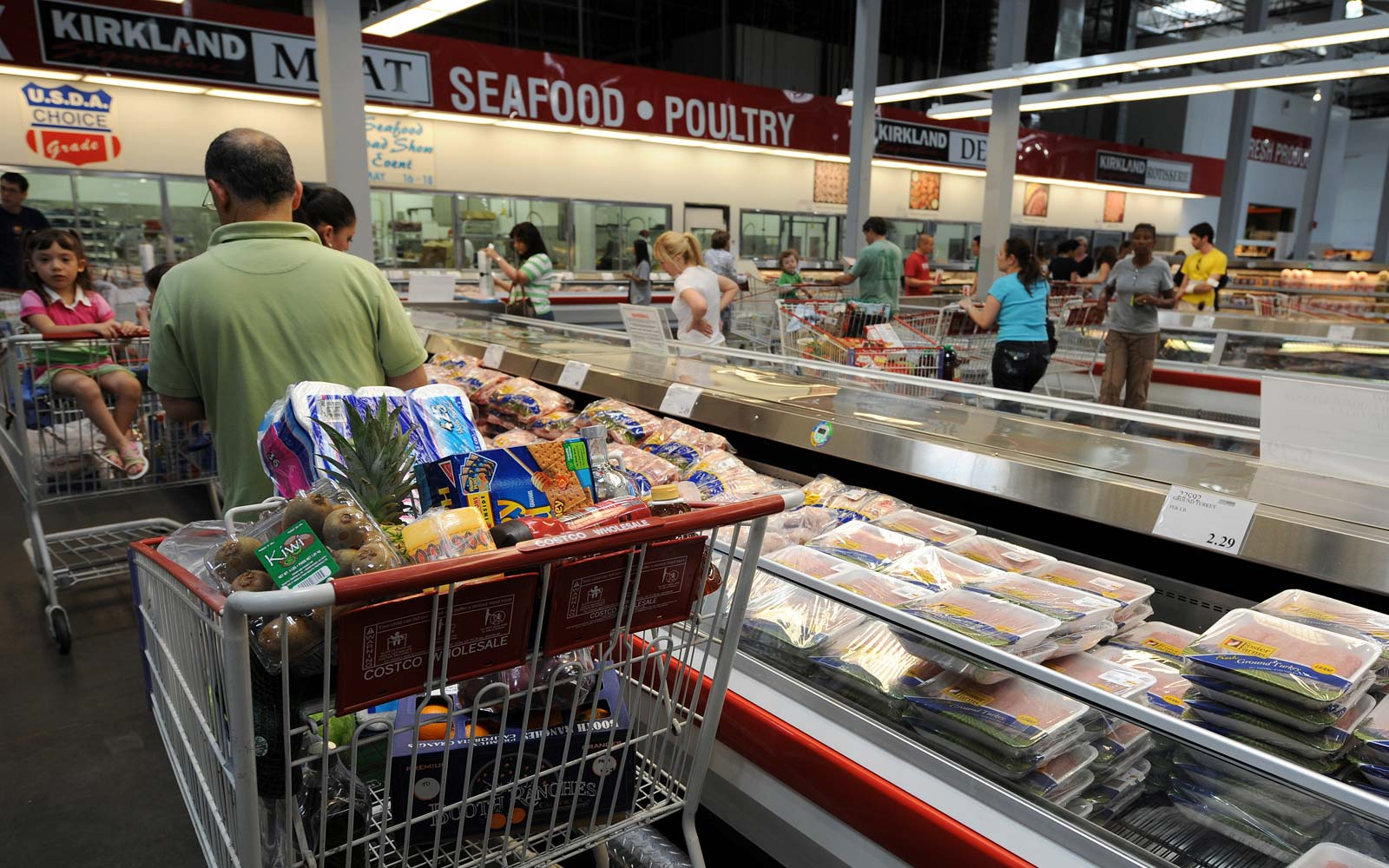 People shop at the low cost, high volume supermarket warehouse Costco