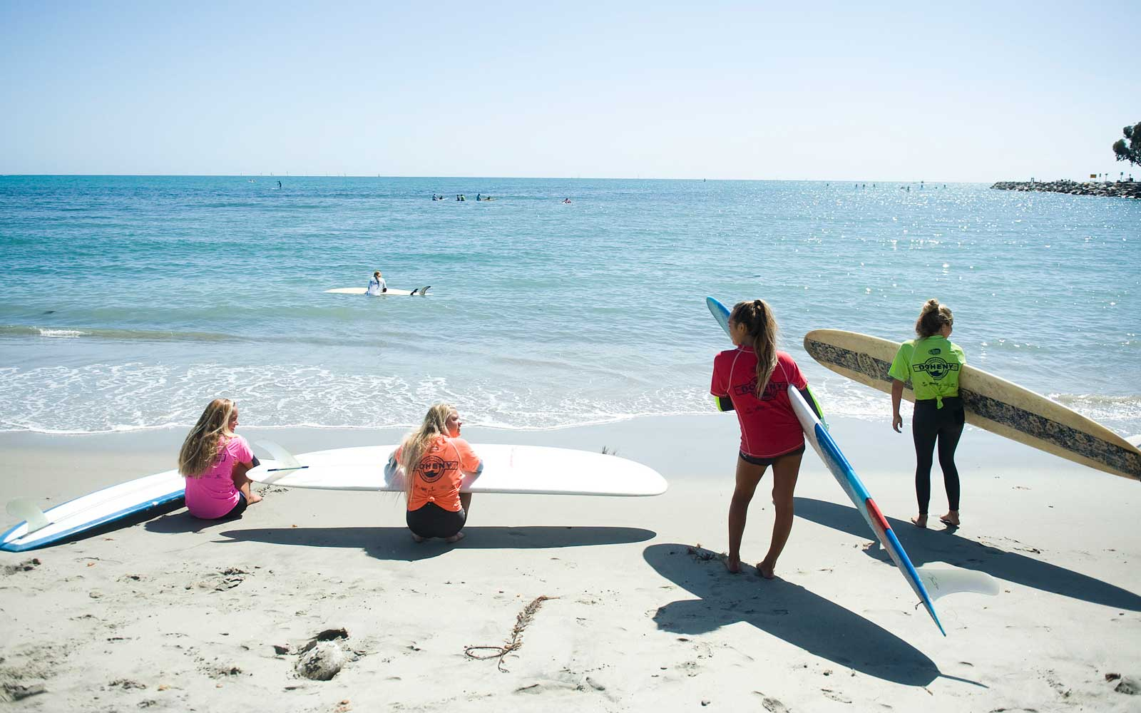 Competitors in the Junior Women's Final wait for the start of their heat during the Doheny Longboard Surfing Association?ïs annual Velzy Surf Contest and Luau Saturday afternoon