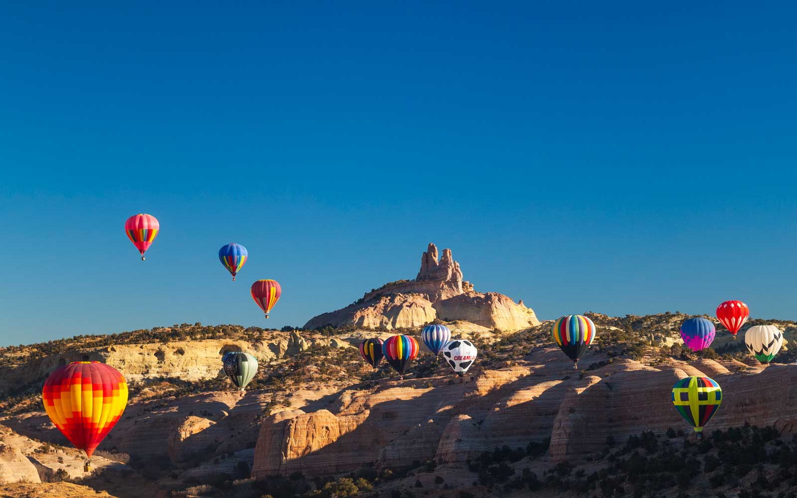 Hot Air balloons with Church Rock in background; Red Rock Balloon Rally at Red Rock State Park, Gallup, New Mexico