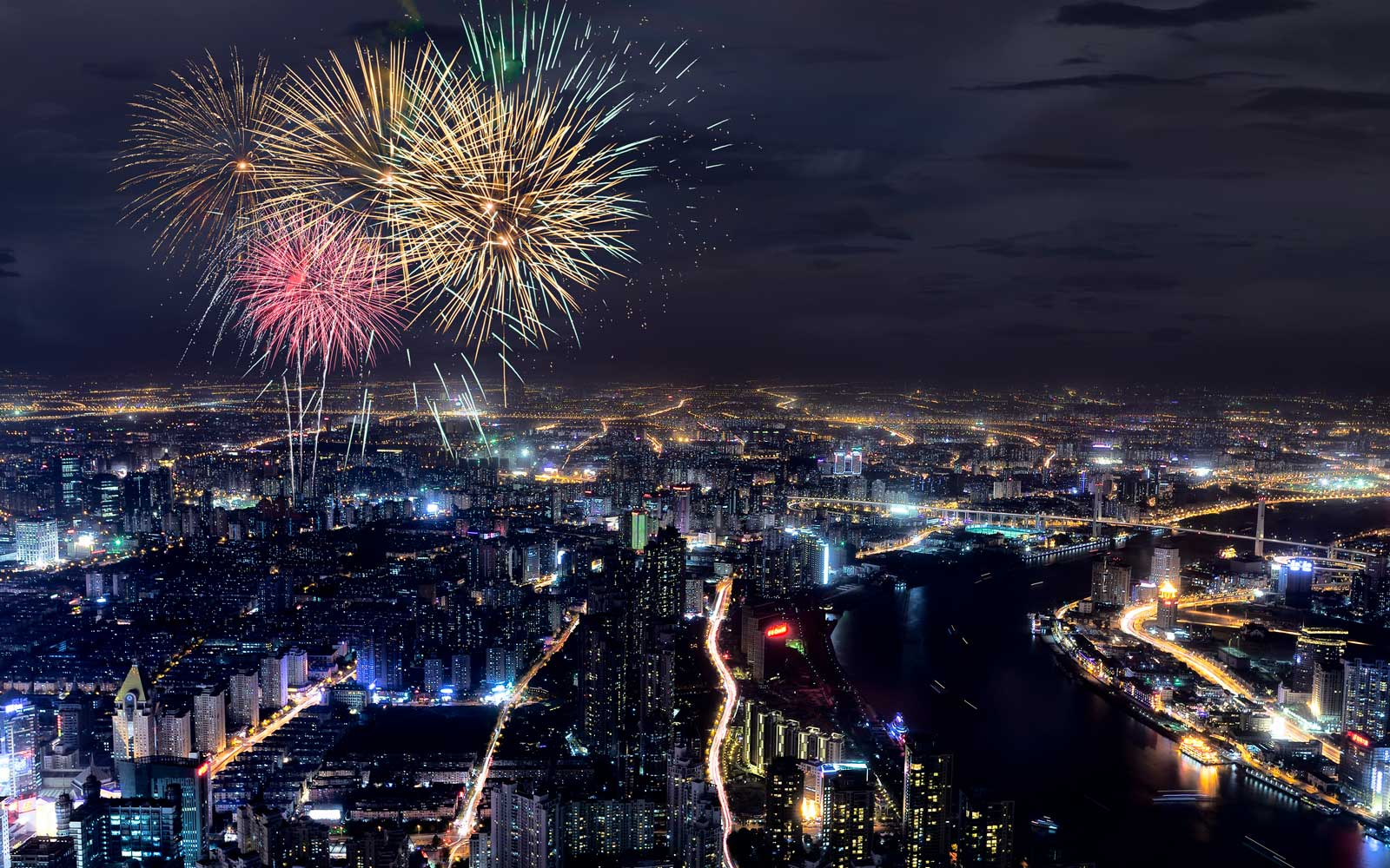 Festival fireworks under the Shanghai city at night
