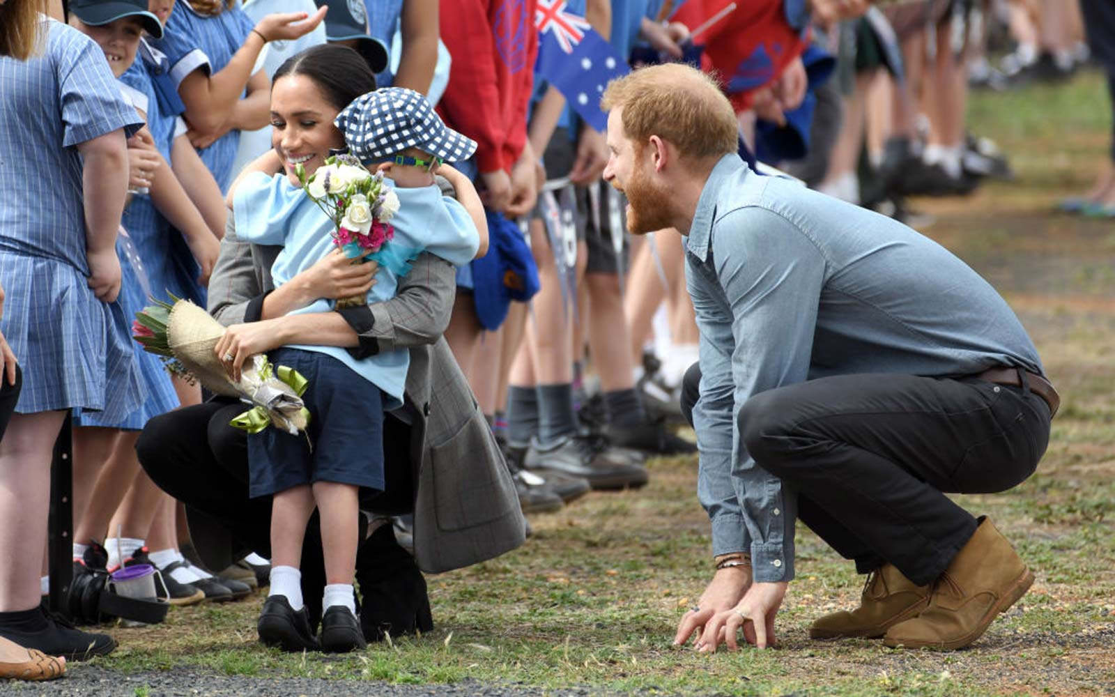 Prince Harry, Duke of Sussex and Meghan, Duchess of Sussex arrive at Dubbo airport and is greeted by 5 year old Luke Vincent