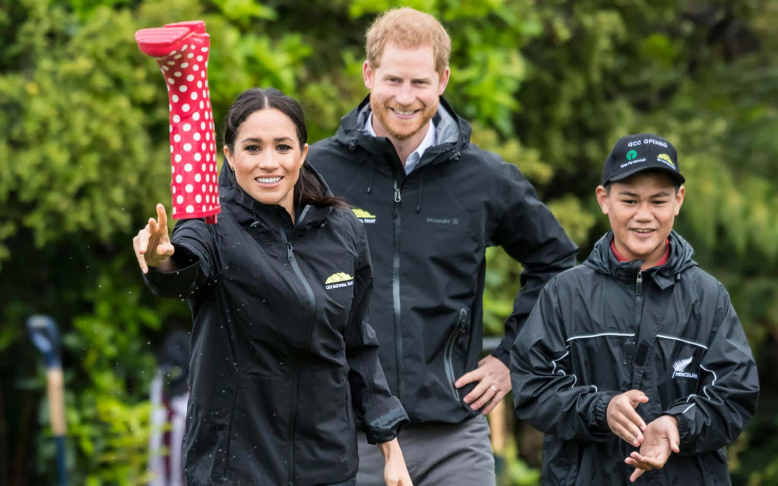 Britain's Meghan, Duchess of Sussex participates in a gumboot throwing competition with Prince Harry after unveiling a plaque dedicating 20 hectares of native bush to the Queen's Commonwealth Canopy project