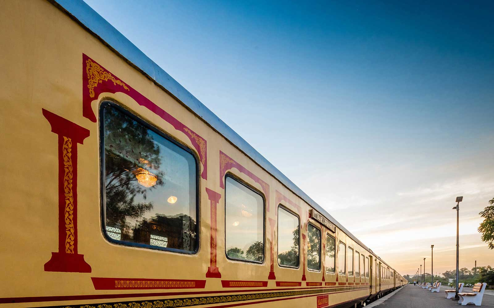 Exterior of the Palace on Wheels luxury train in India, painted in its signature cream and red