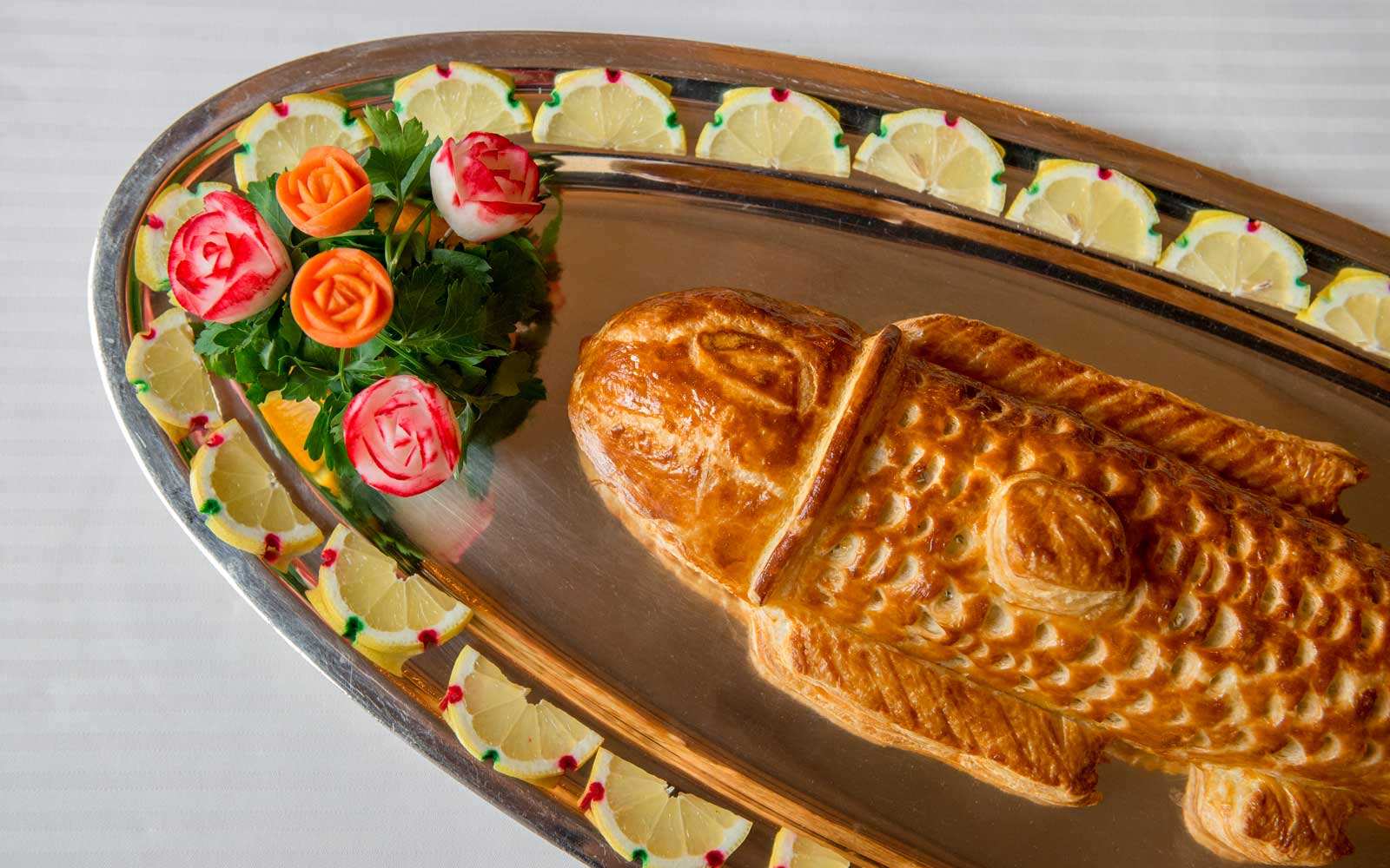Fish in puff pastry at the Paul Bocuse restaurant in Lyon, France