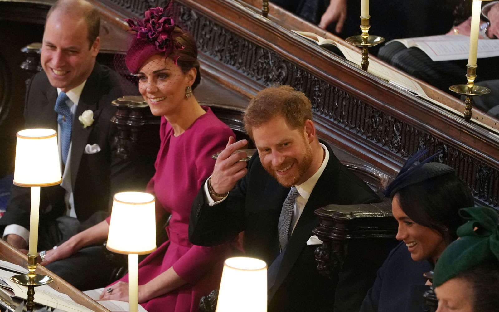 Prince William, Duke of Cambridge, Catherine, Duchess of Cambridge, Prince Harry, Duke of Sussex, Meghan, Duchess of Sussex and Princess Anne, Princess Royal, react during the wedding ceremony of Princess Eugenie of York to Jack Brooksbank.
