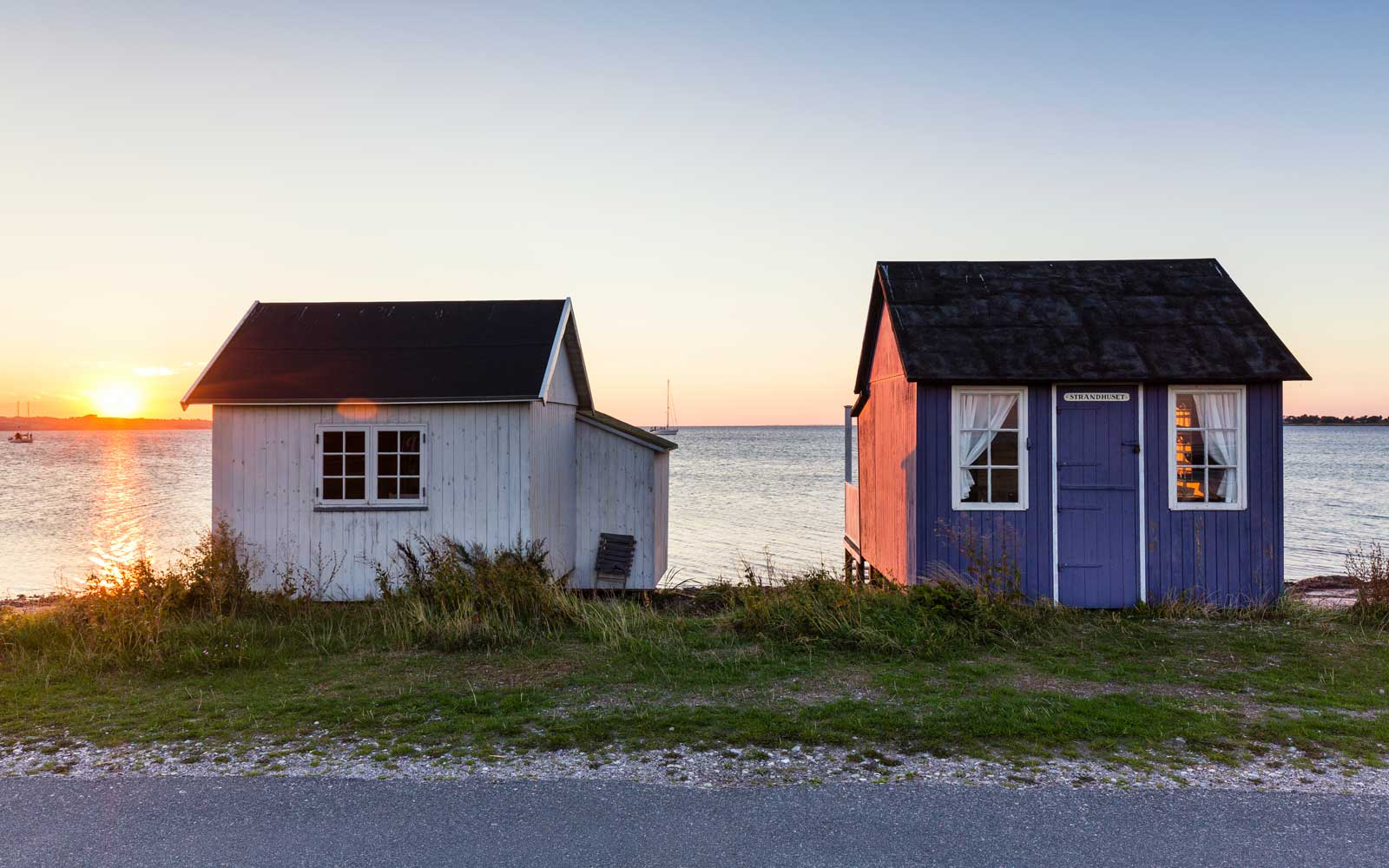 Beach huts at sunset, Aero Island, Denmark