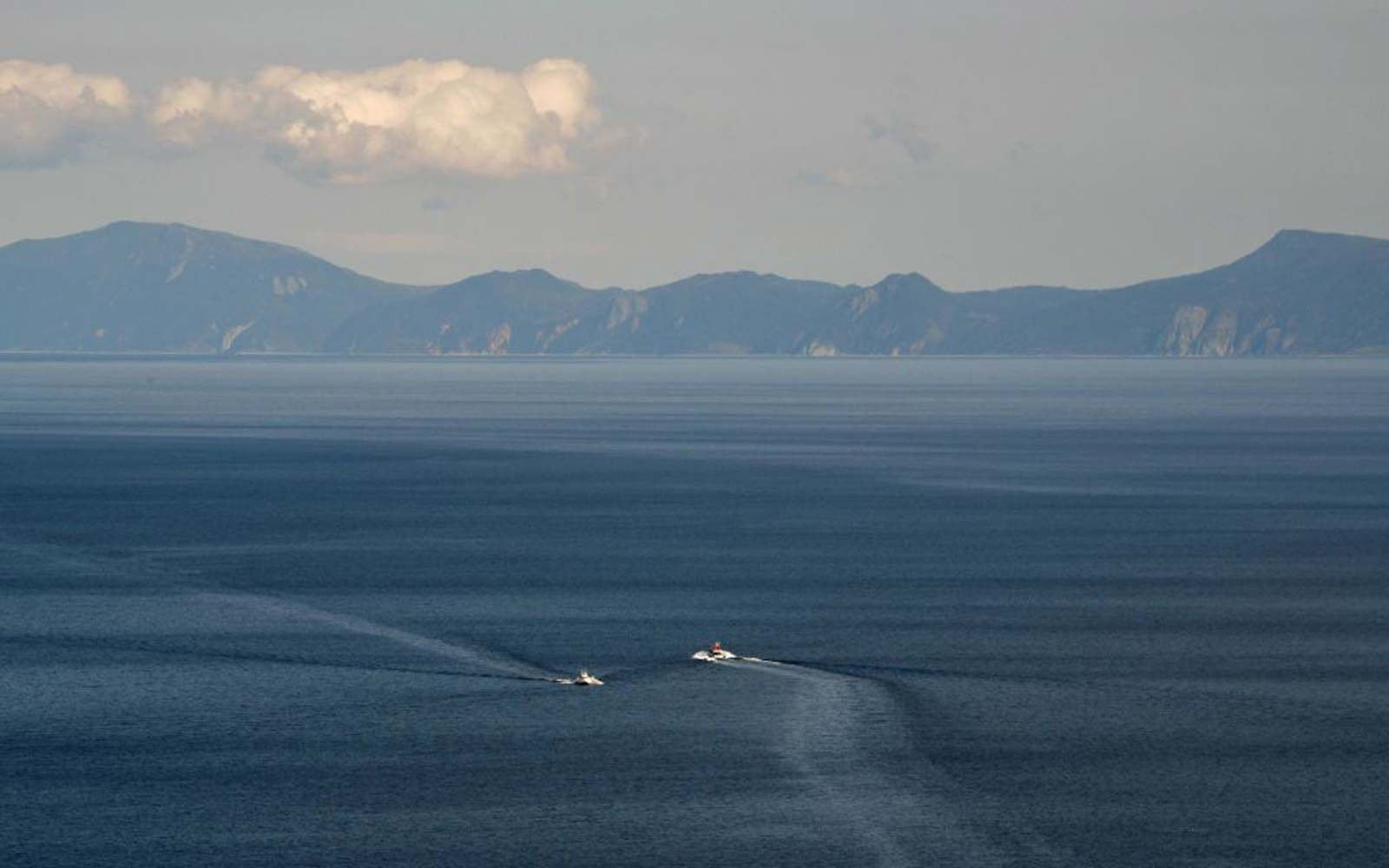 This picture taken on October 10, 2018 shows Kunashiri island, part of an archipelago under Russian control, visible from the Rausu Kunashiri Observatory Deck in Rausu, Hokkaido prefecture