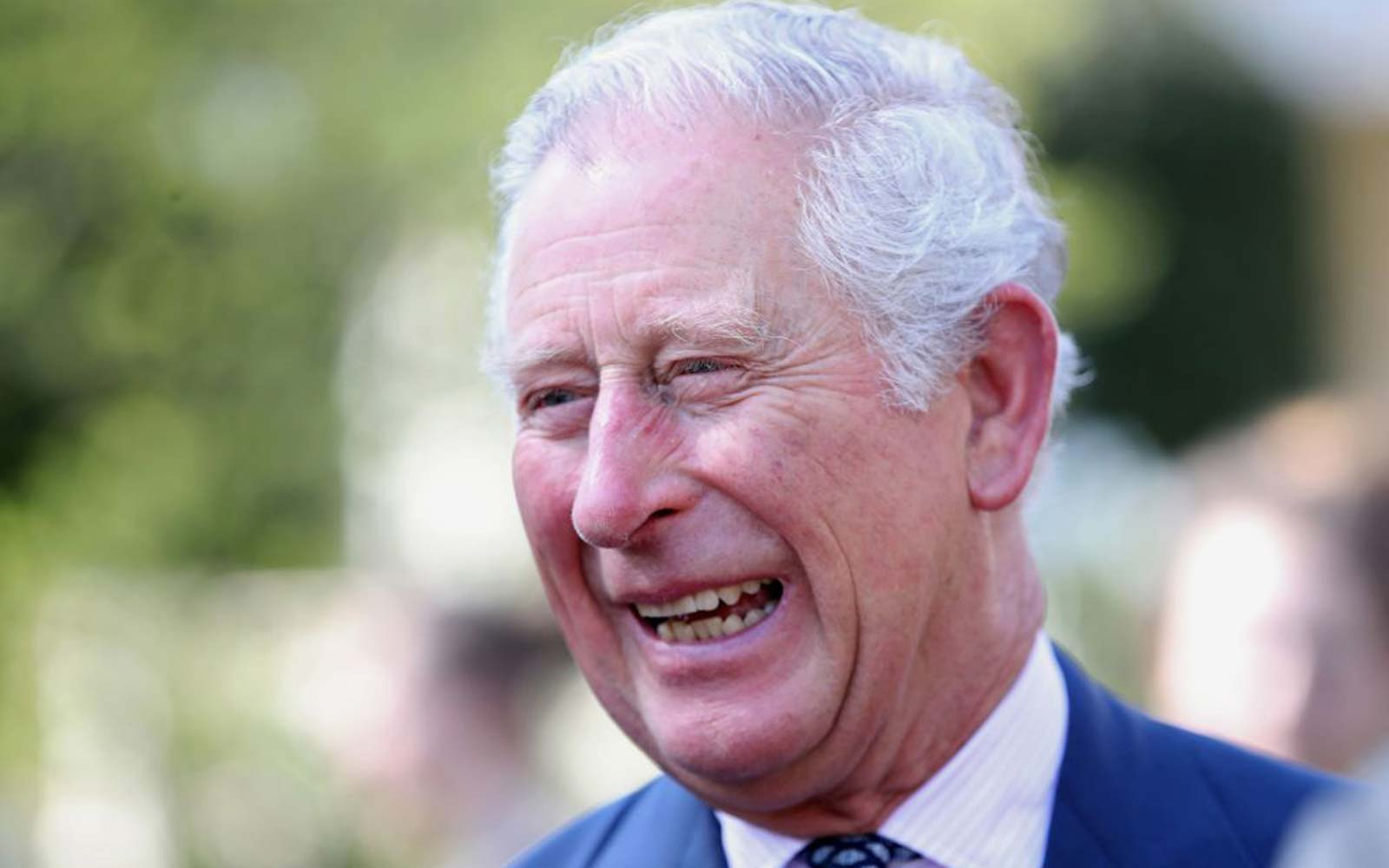 Britain's Prince Charles, Prince of Wales, President of The Prince's Trust Group, laughs with guests at a reception for The Prince's Trust International