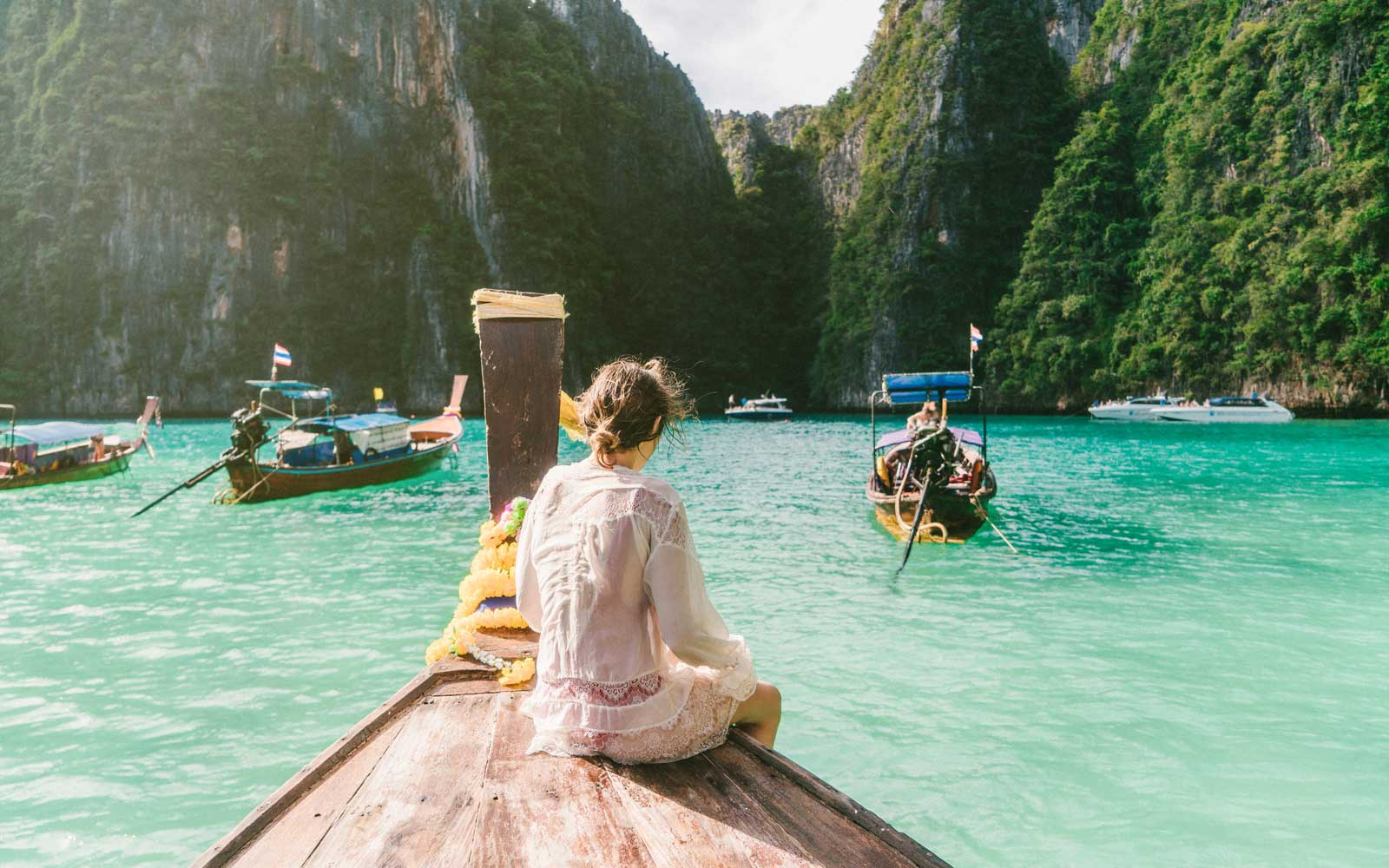 Young Caucasian woman in Thai Taxi boat in Krabi, Thailand