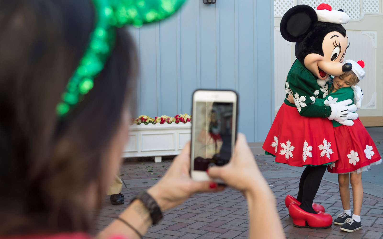 Minnie Mouse poses for photo during the holidays at Disneyland Resort