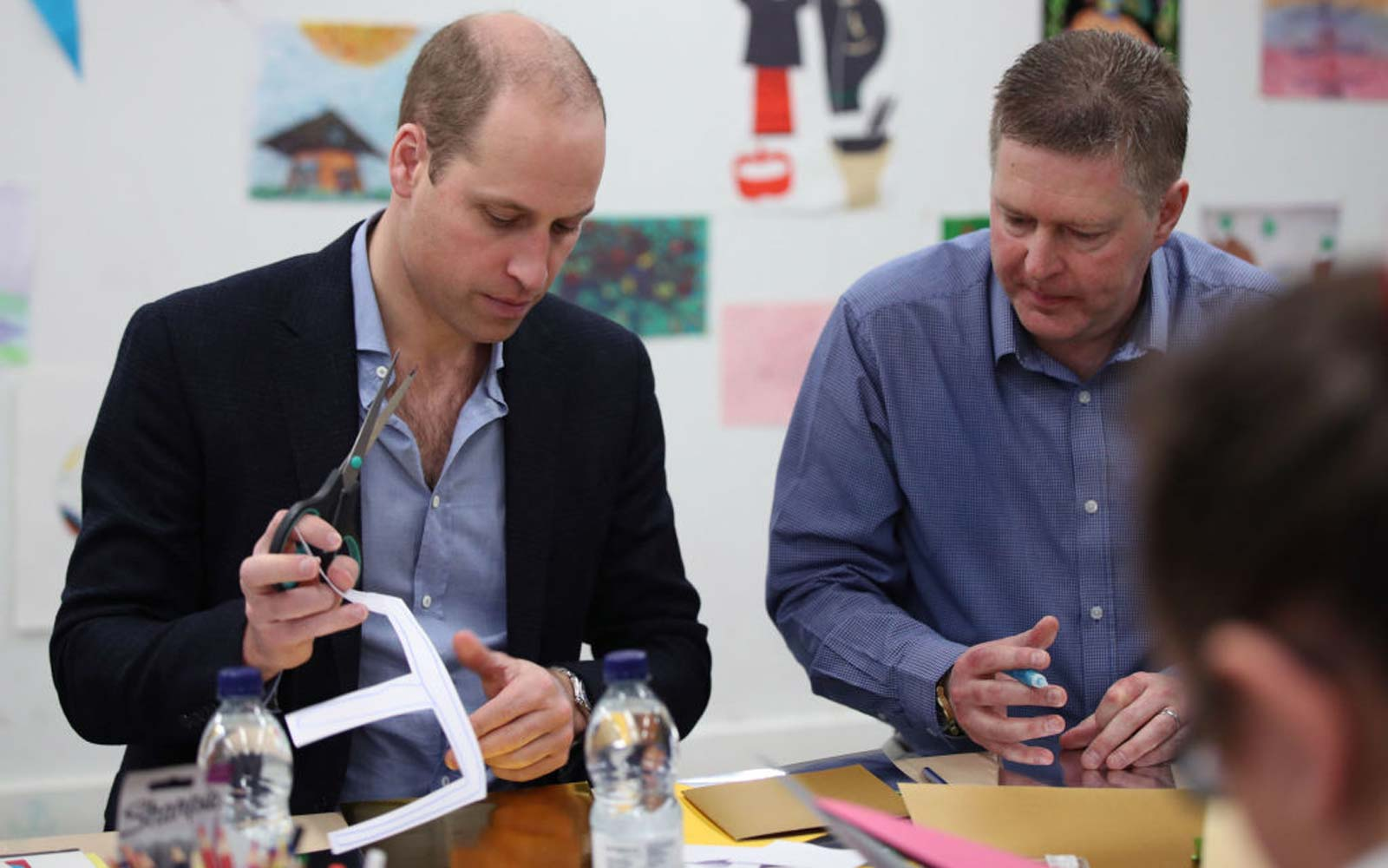 Prince William, Duke of Cambridge alongside Mick Clarke, Chief Executive takes part in an arts and craft session