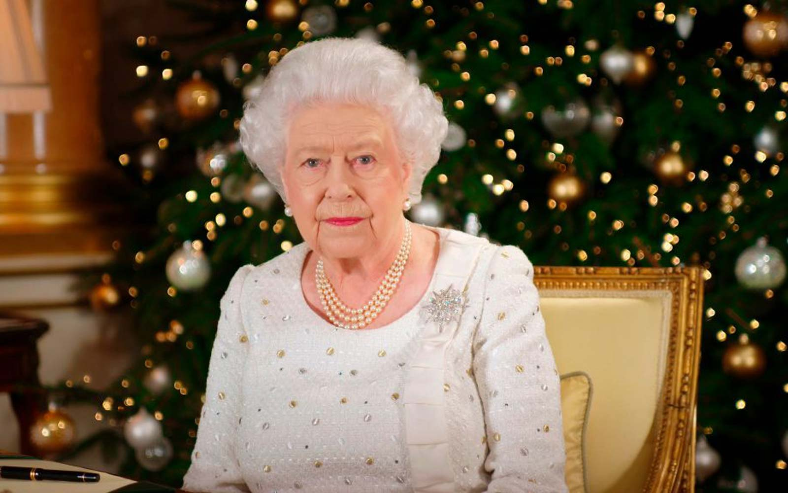 Britain's Queen Elizabeth II poses at a desk in the 1844 Room at Buckingham Palace, London, on December 13, 2017