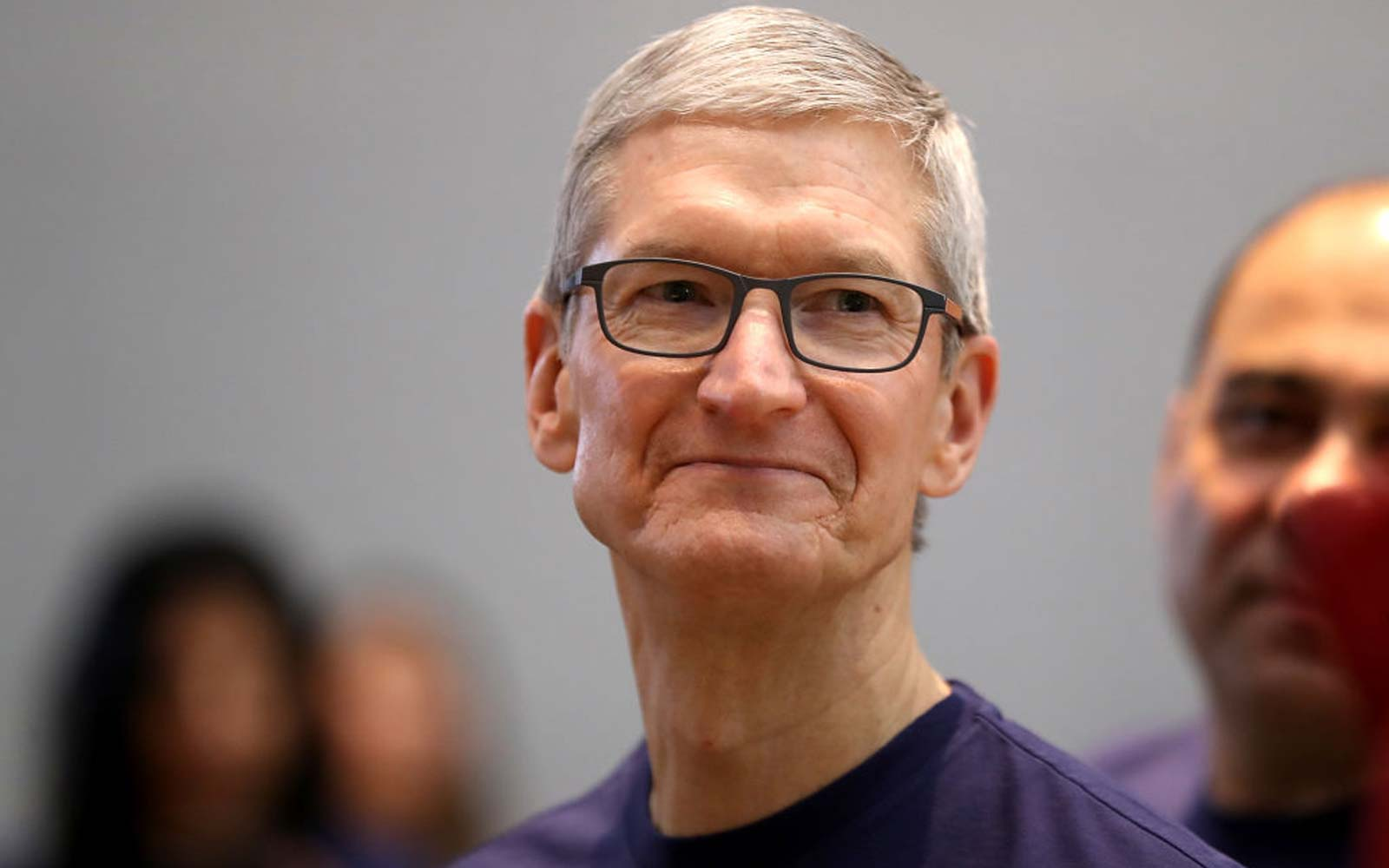 Tim Cook looks on as the new iPhone X goes on sale