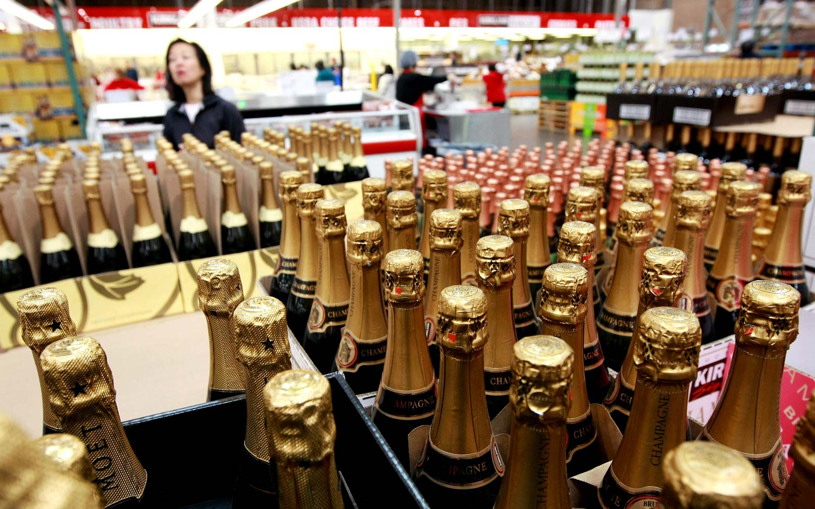 A Costco customer shops for champagne