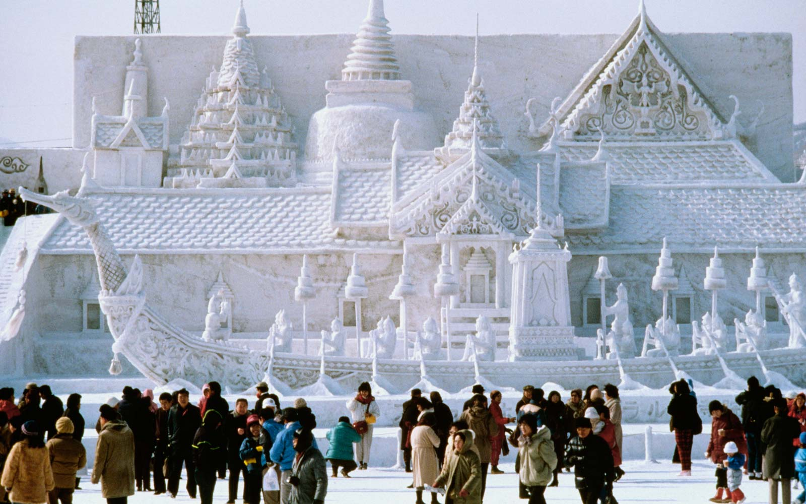 Tourist in front of a snow sculpture, Bangkok's Royal Palace, Snow Festival, Sapporo, Japan
