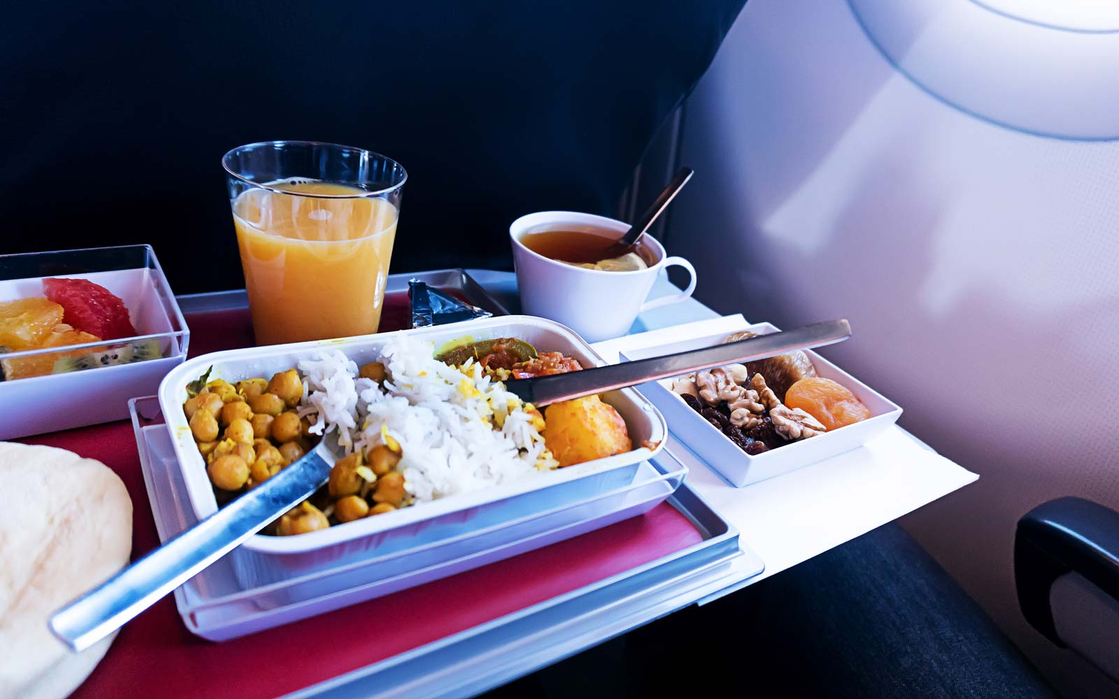 photo of Food served on board of economy class airplane on the table