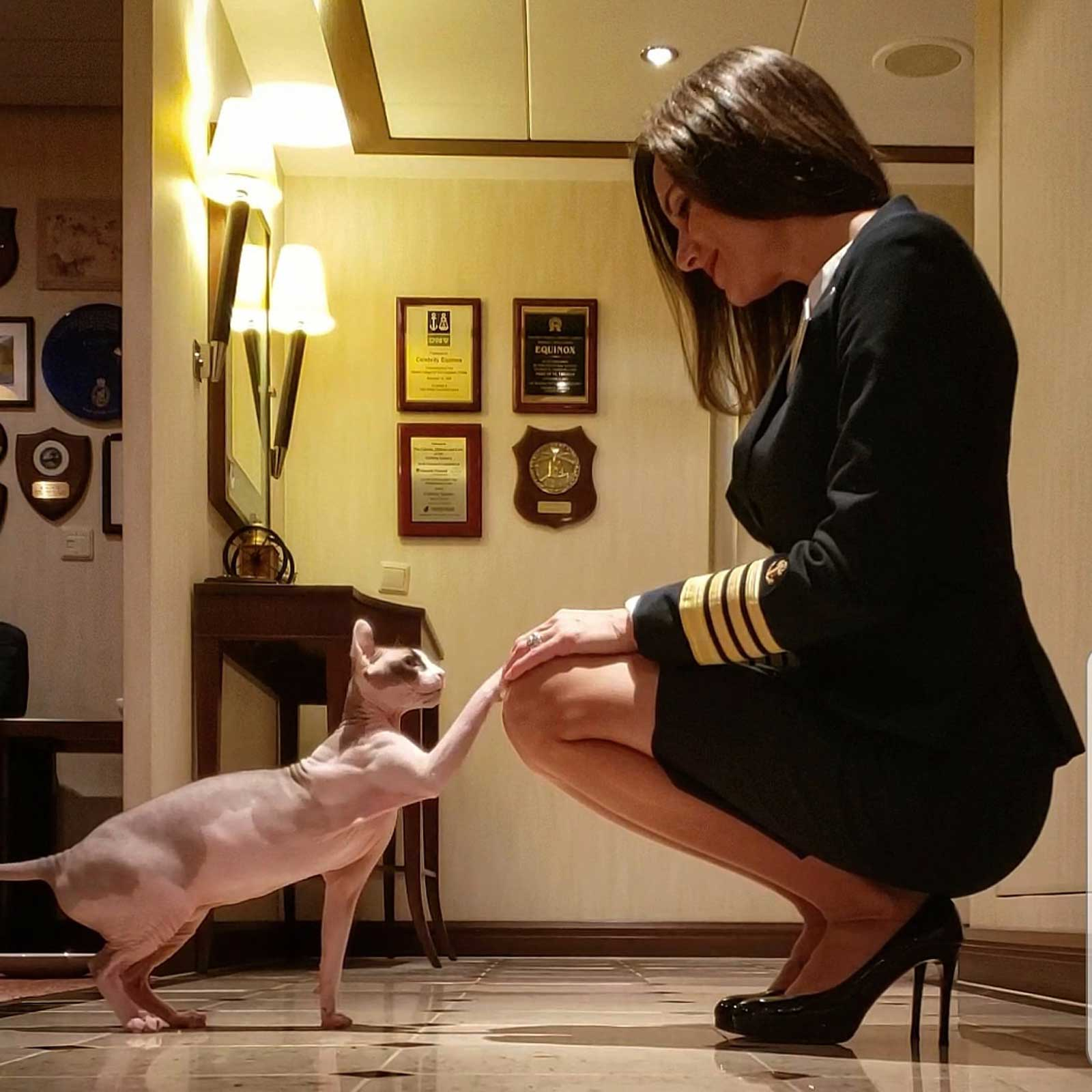 America's First Female Cruise Captain Travels the World With Her Adorable Sphynx Cat
