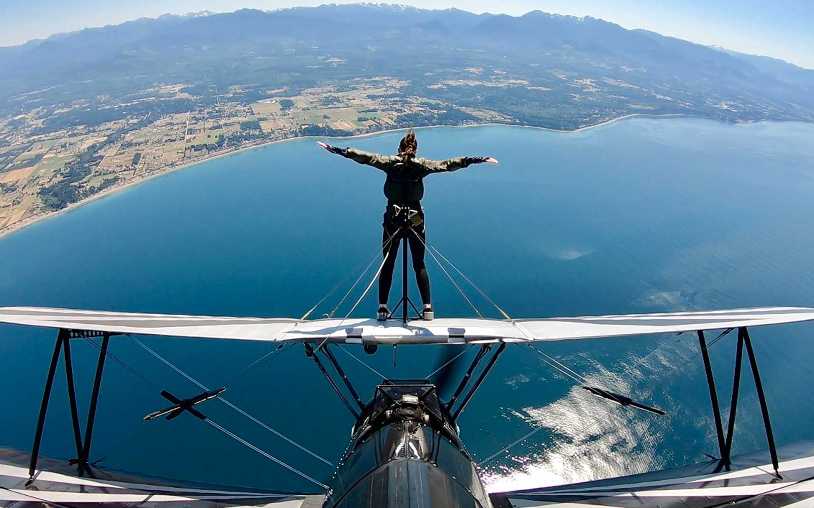 This Stunt-loving Flight Attendant Celebrated Her 50th Birthday by Walking on the Wings of an Airplane