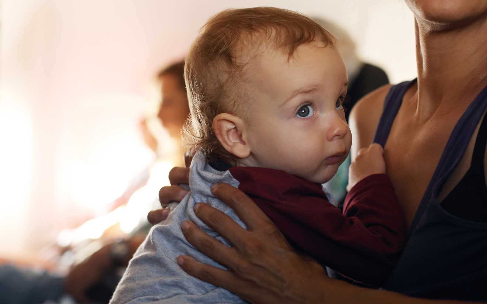 Toddler with mother on airplane