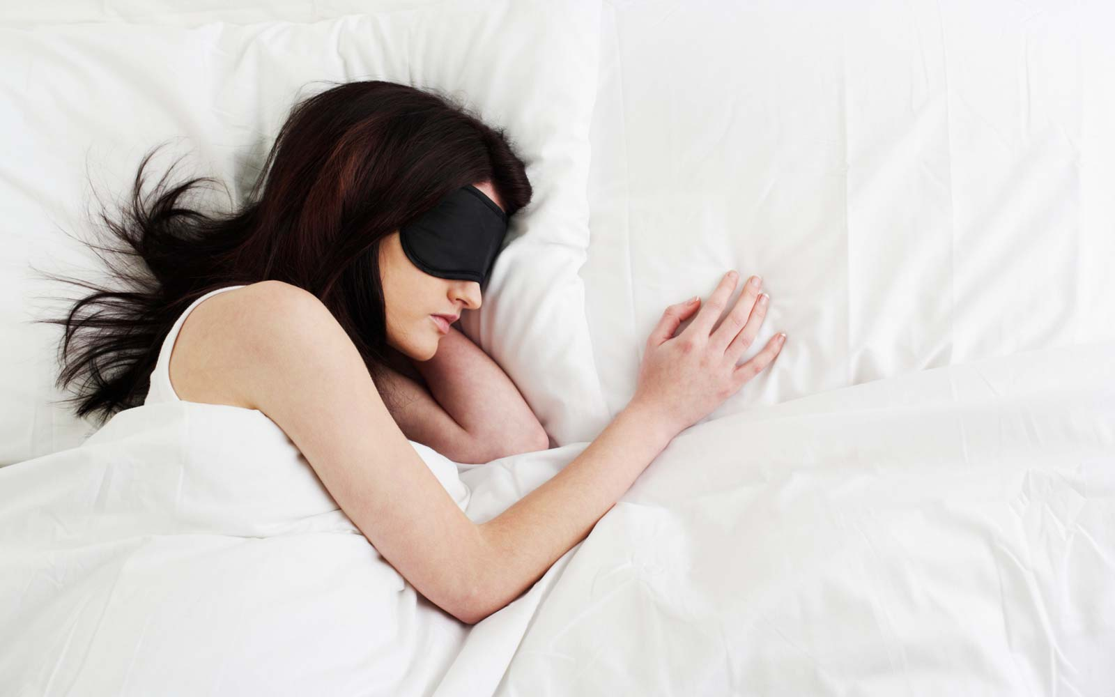 Young woman sleeping with sleep mask