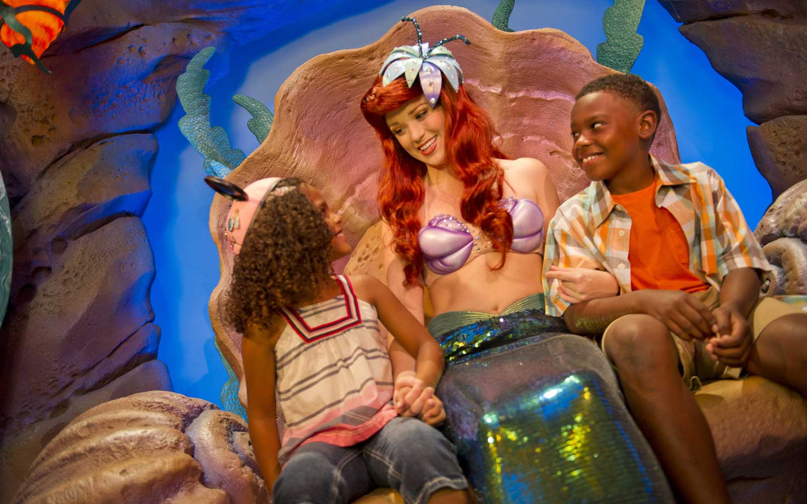 Ariel, the Little Mermaid, with guests at Walt Disney World