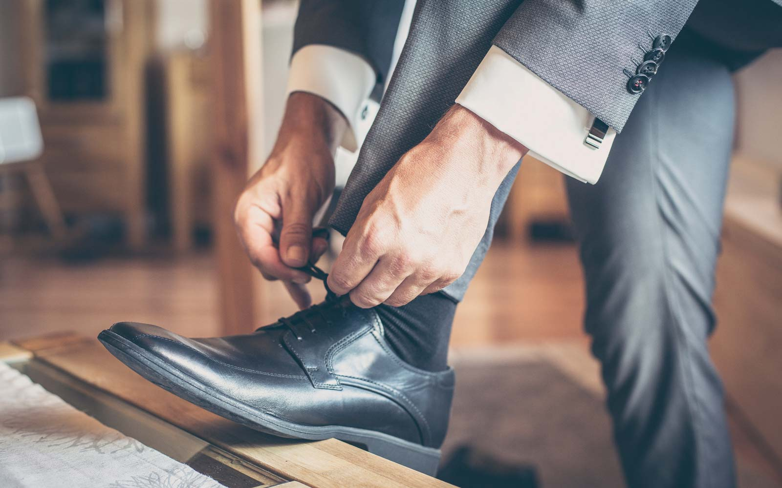 Low Section Of Man Tying Shoes