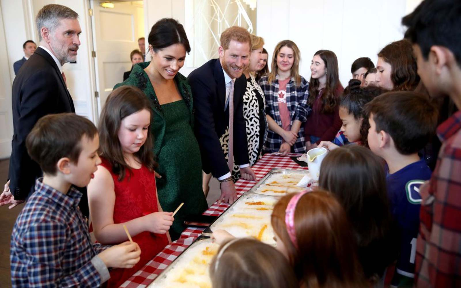 Meghan, Duchess of Sussex and Prince Harry, Duke of Sussex attend a Commonwealth Day Youth Event at Canada House, where they meet young people who demonstrate a Canadian spring tradition of making maple taffy
