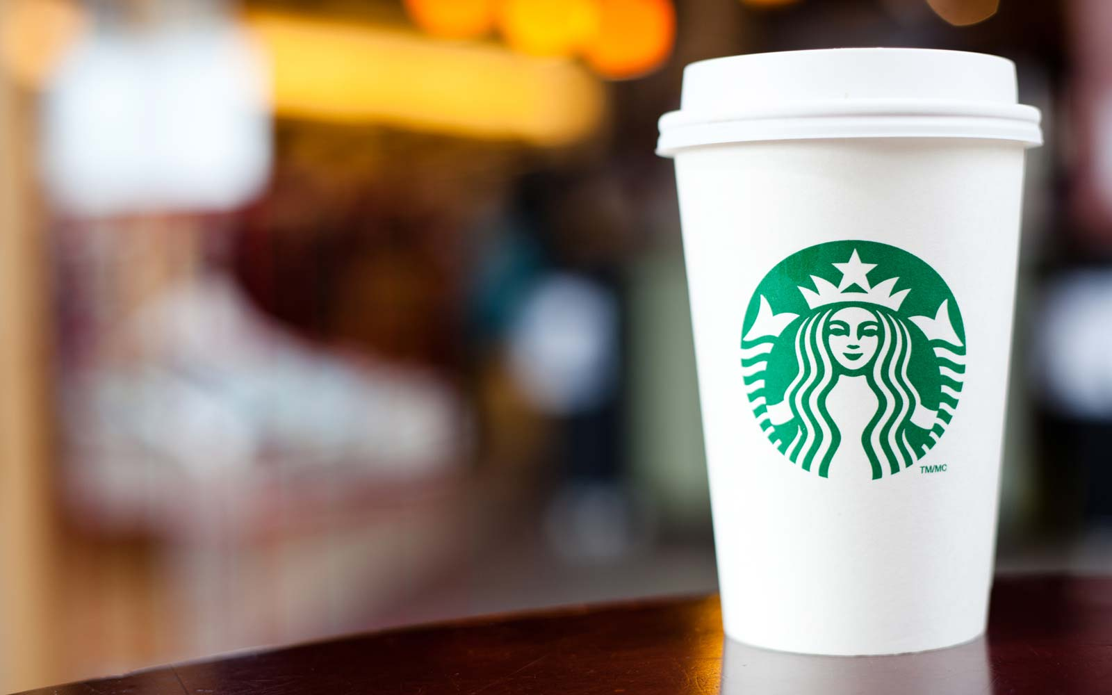 Grande Starbucks to go cup on table