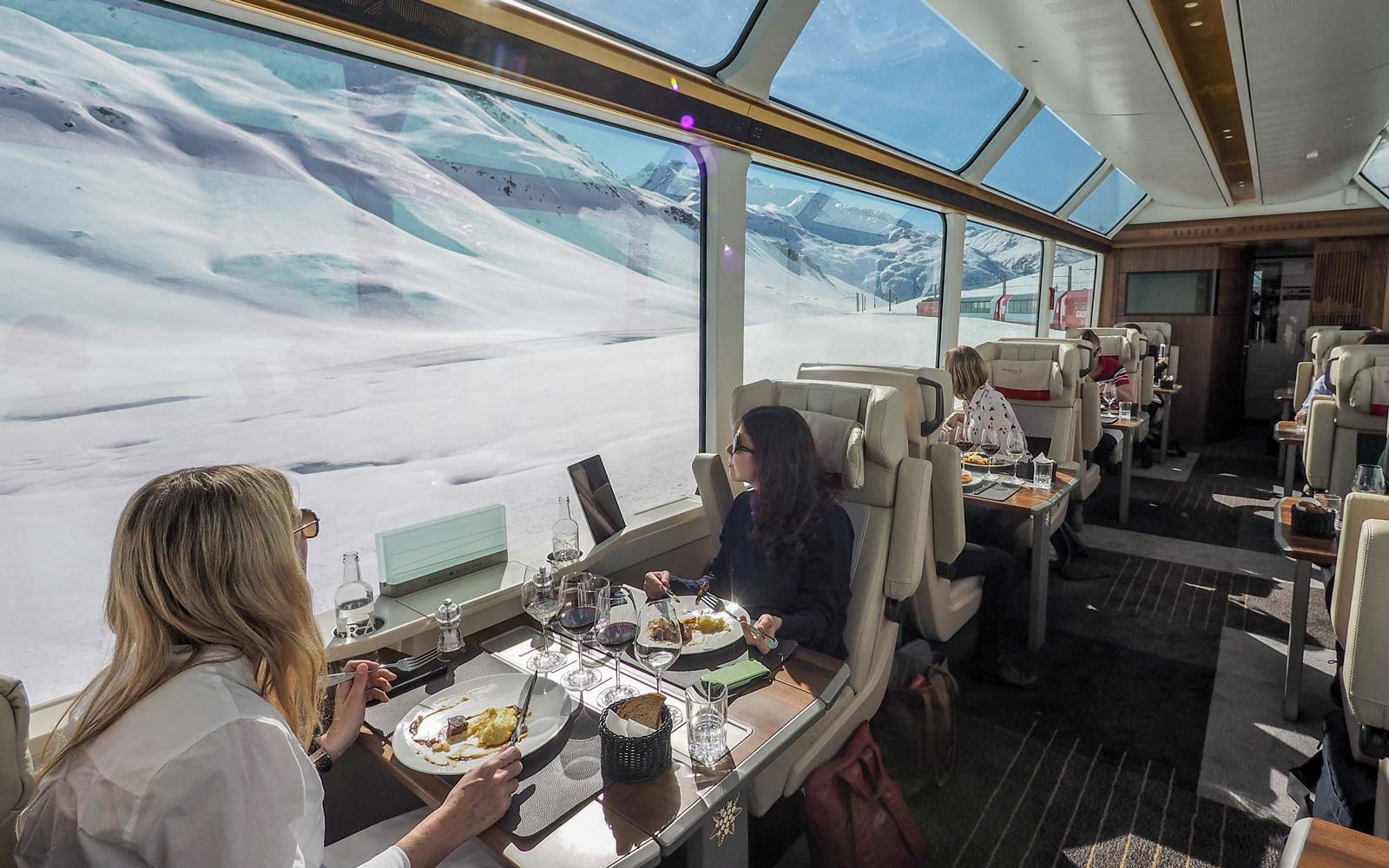 Switzerland's Glacier Express Train Unveils New 'Excellence' Class Complete With Panoramic Views of the Swiss Alps and 7-course Meals