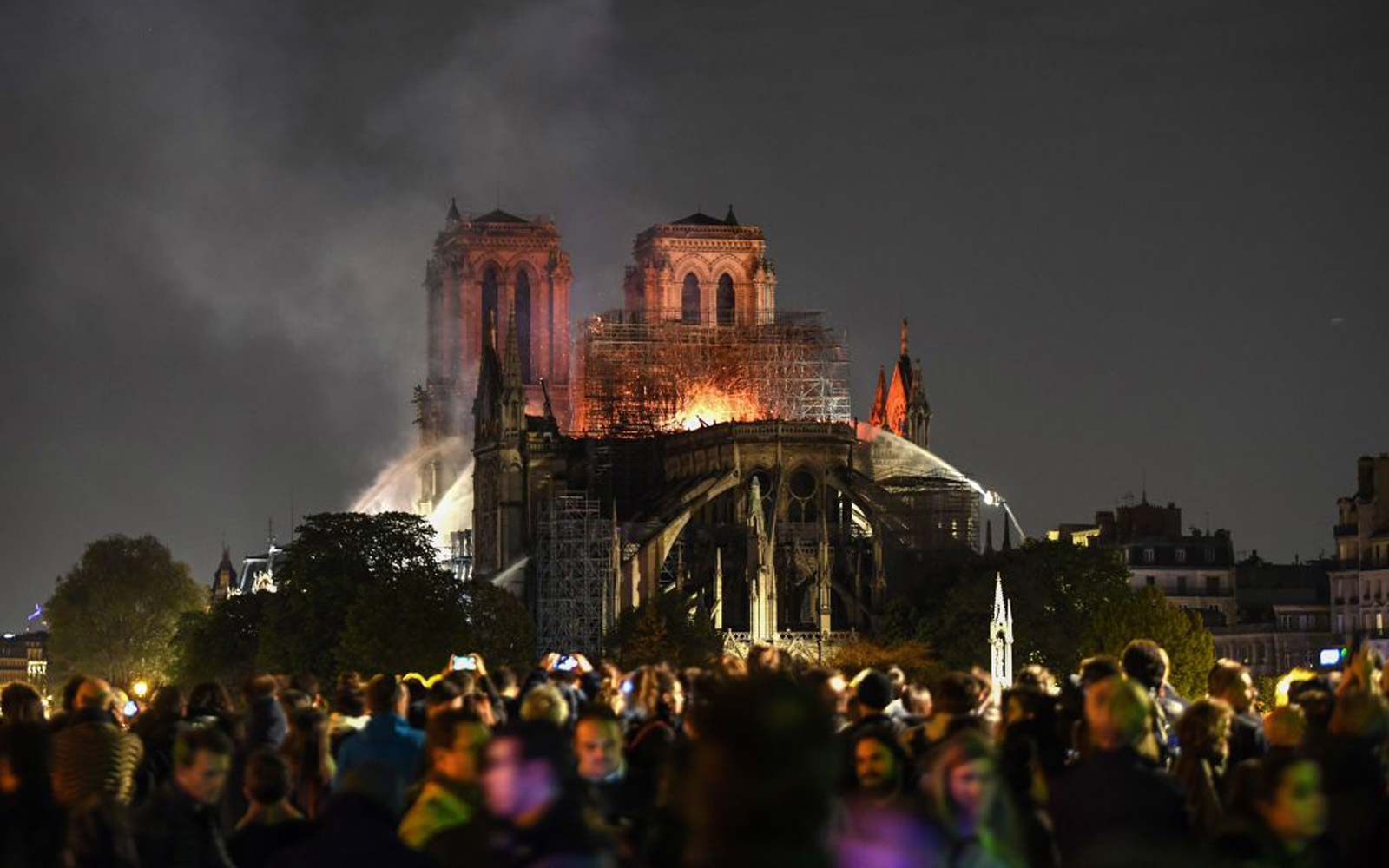 Watch Crowds in Paris Sing 'Ave Maria' While Watching Fire at Notre Dame Cathedral