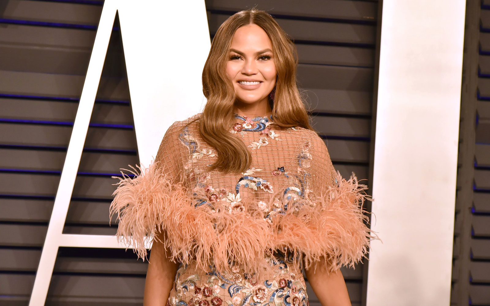Chrissy Teigen Really Wants to Take an RV Trip Across America With John Legend