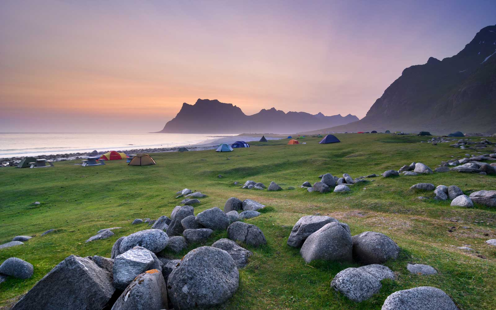 Midnight sun illuminates sky over Uttakleiv Beach, Vestvagoy, Lofoten Islands, Norway