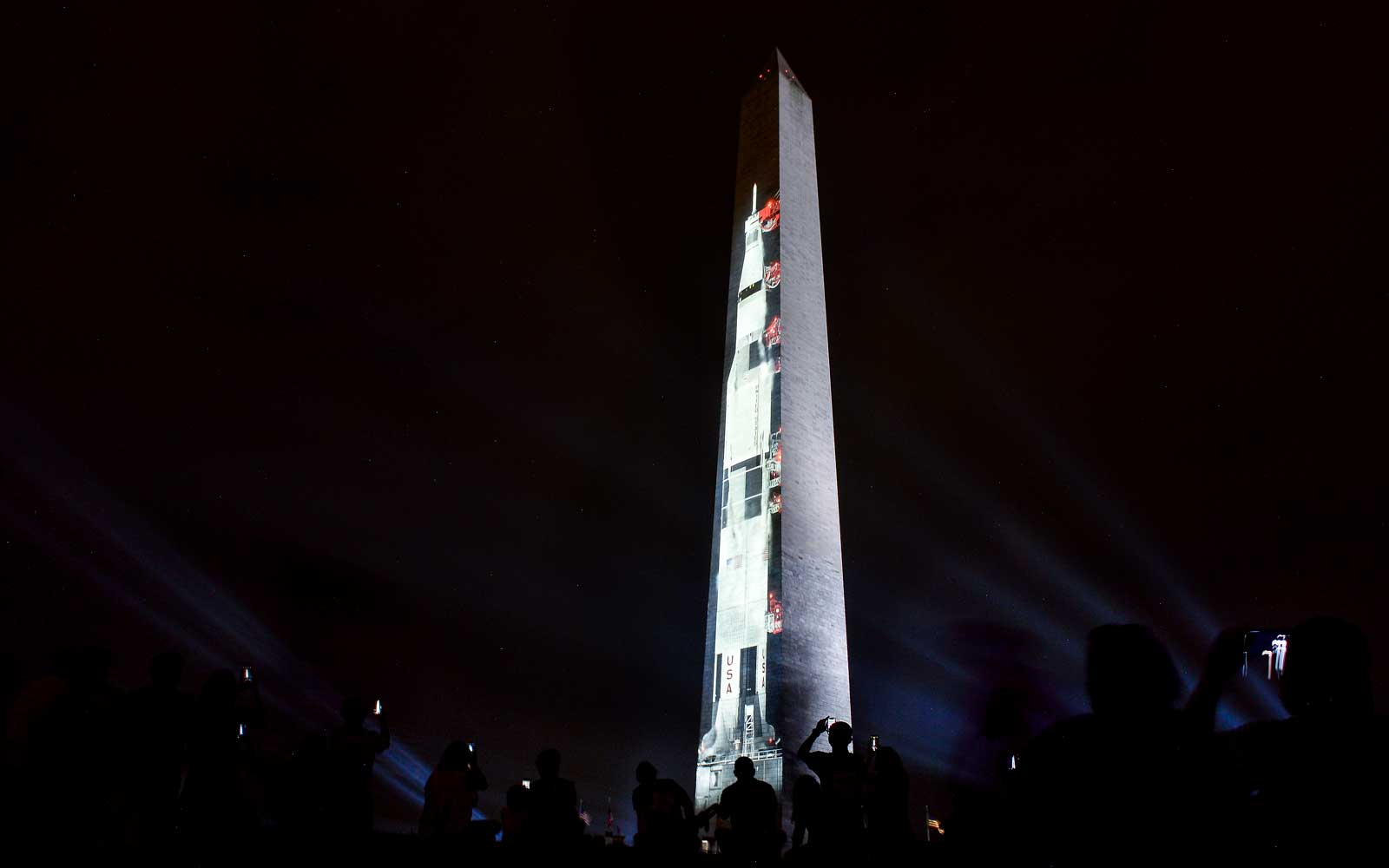 An image of a Saturn V, the rocket that sent Apollo 11 into orbit on July 16, 1969, is projected on the Washington monument in Washington, DC on July 16, 2019, in honor of the 50th anniversary of Apollo 11 and when man walked on the moon.