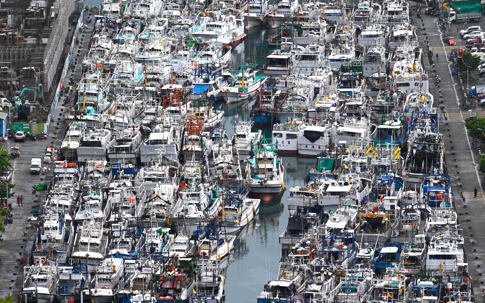 This overview shows fishing boats packed into the typhoon shelter at Nanfangao harbour in Suao, Yilan county, as Typhoon Lekima approaches off the shores of eastern Taiwan on August 8, 2019.