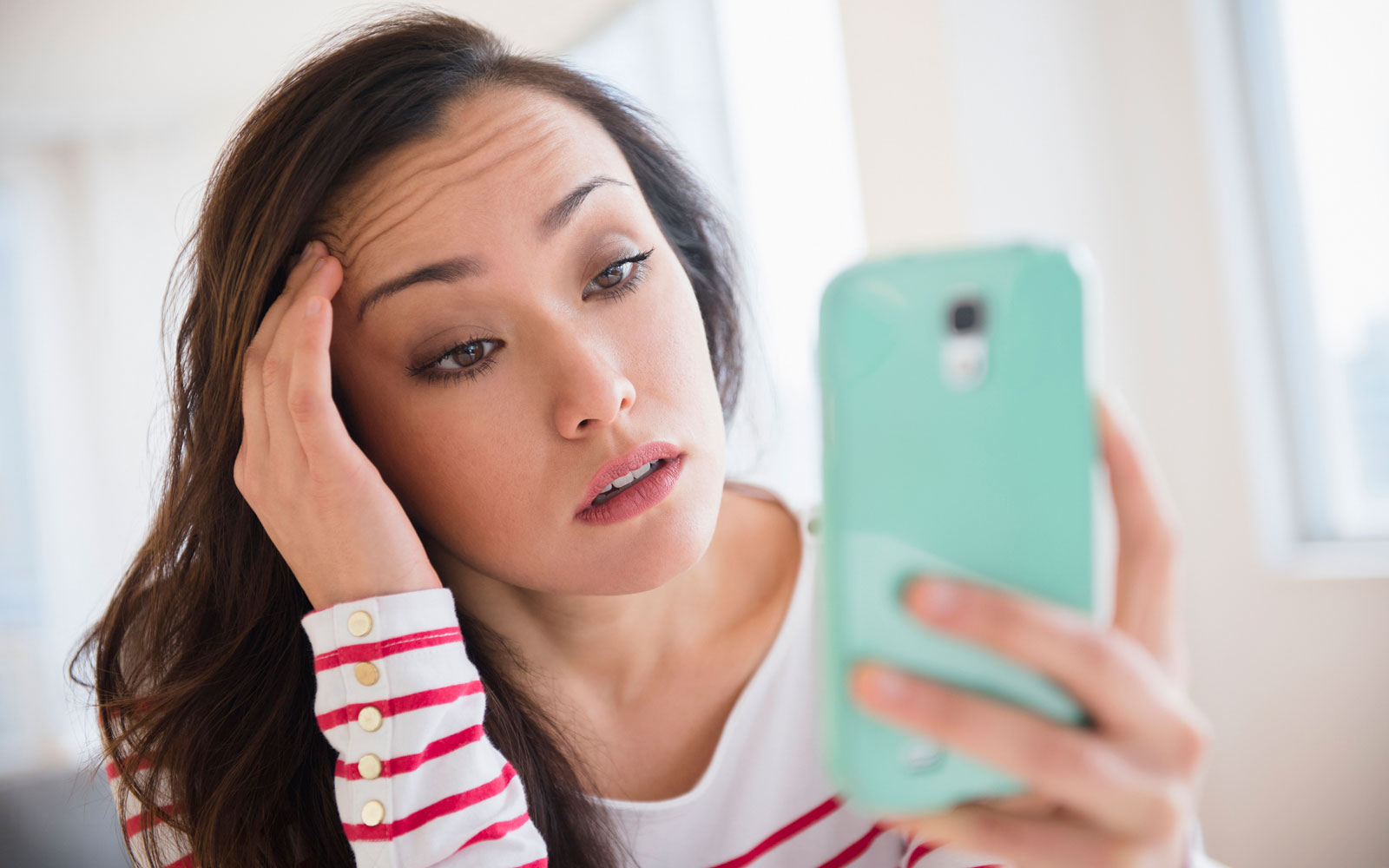 Stressed woman using cell phone